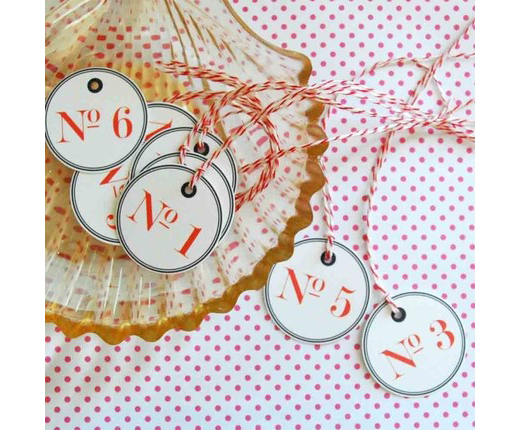 adorable tags from this great Etsy site,   May Third  , would make the cutest table numbers.
