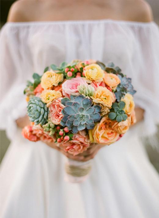 bride with succulent bouquet.jpeg