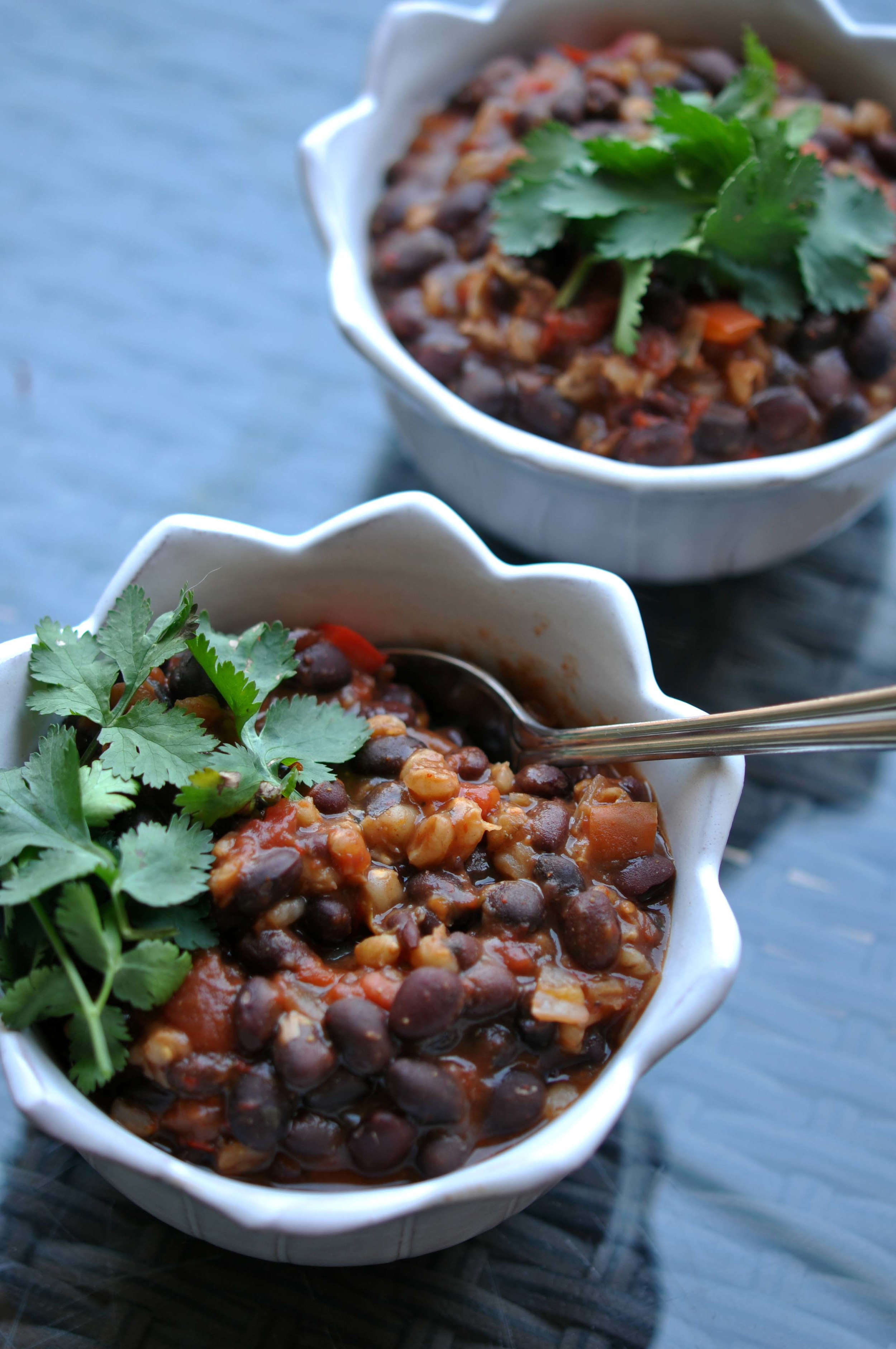 Slow Cooker Black Bean Chili with Bulgur, Red Bell Peppers, and Onion. This healthy recipe is an easy, vegan meal.