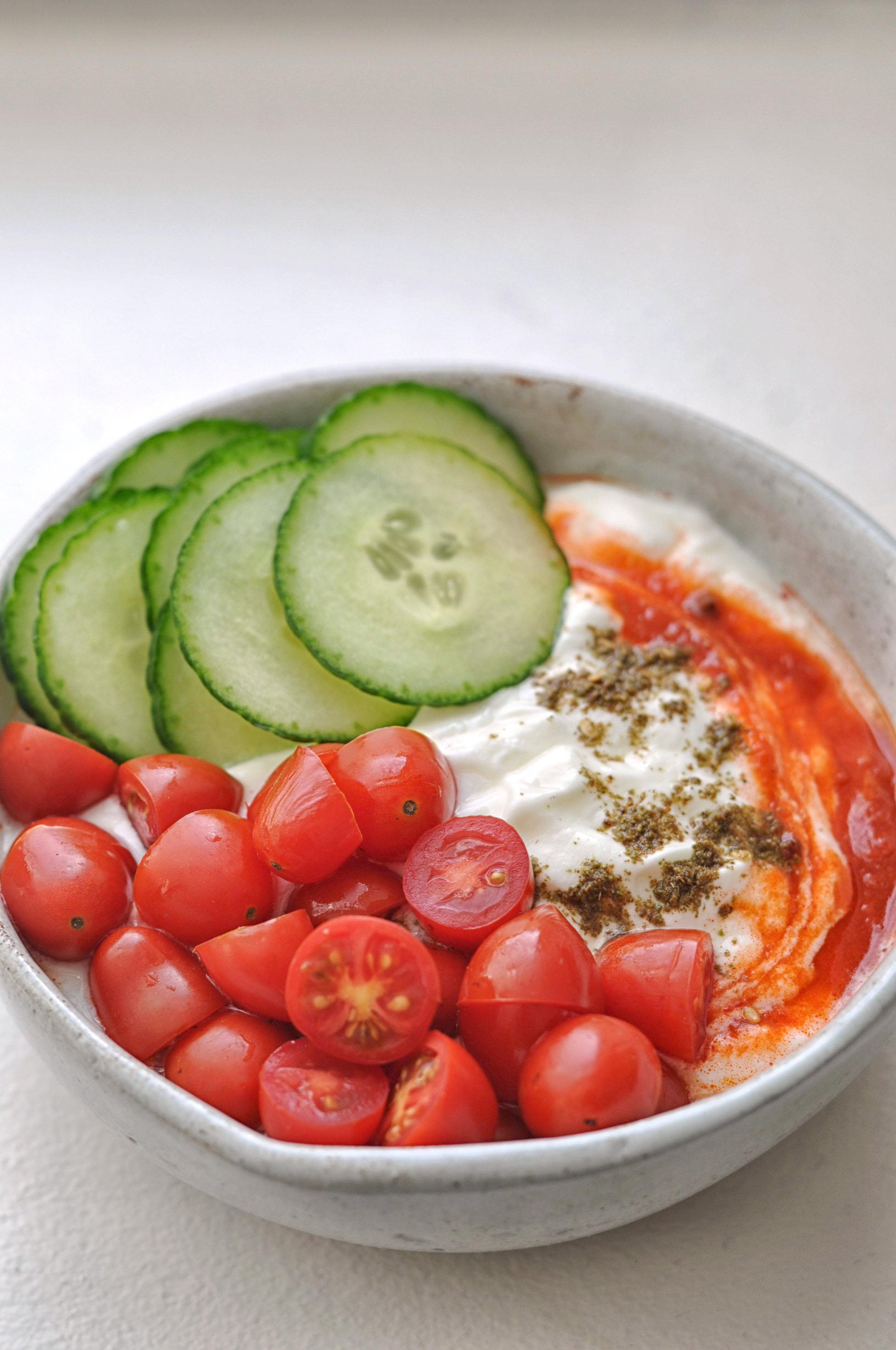 Savory Yogurt with harissa, za'atar, grape tomatoes, and cucumbers - a healthy way to start the day. | Shiny Happy Bright