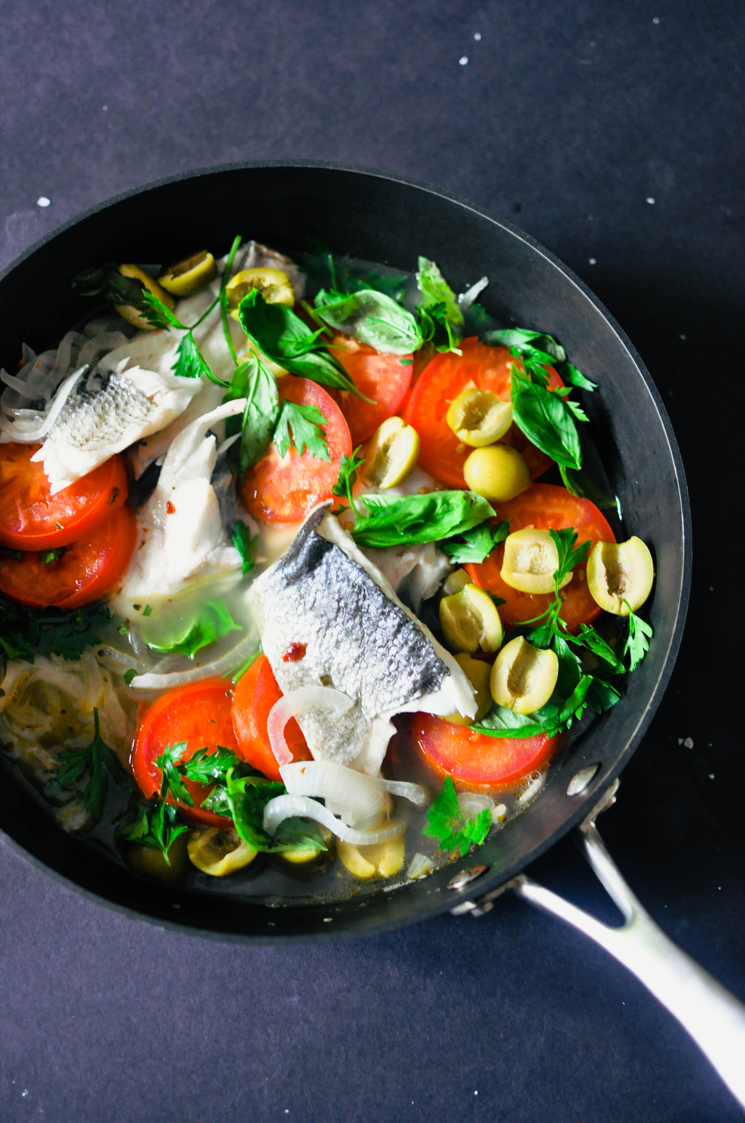 Poached sea bass recipe with tomatoes, olives, and onions | This Healthy Table