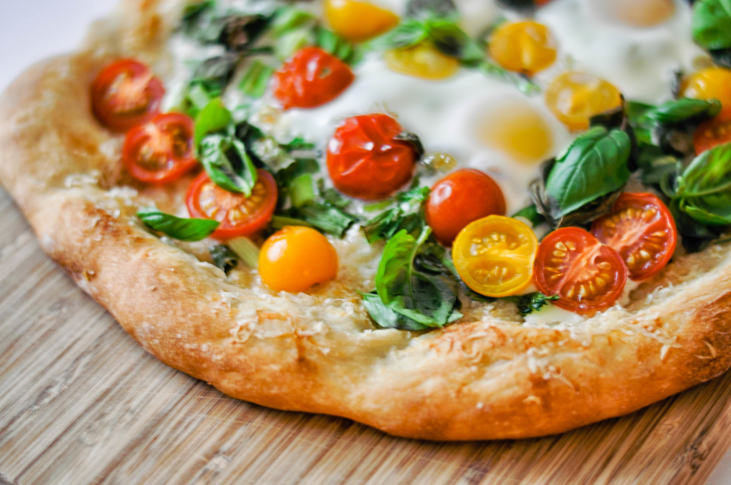 Breakfast Pizza - eggs, tomatoes, green onions, and parmesan on a crunchy pizza crust   This Healthy Table