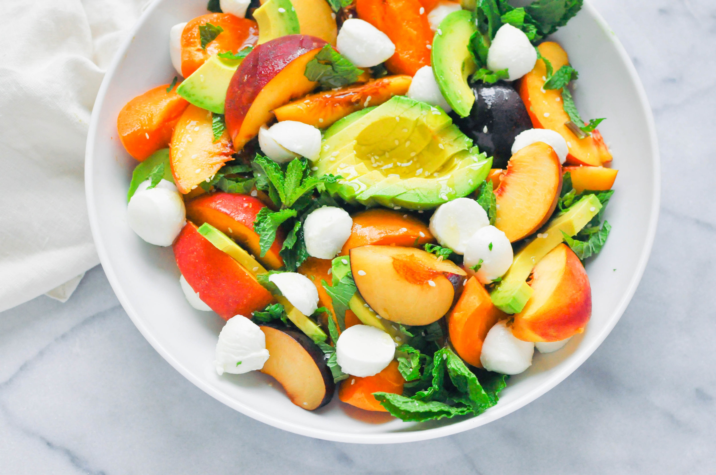 Summer Stone Fruit Salad with peaches, plums, apricots, avocado, and mozzarella - a beautiful celebration of summer produce | This Healthy Table