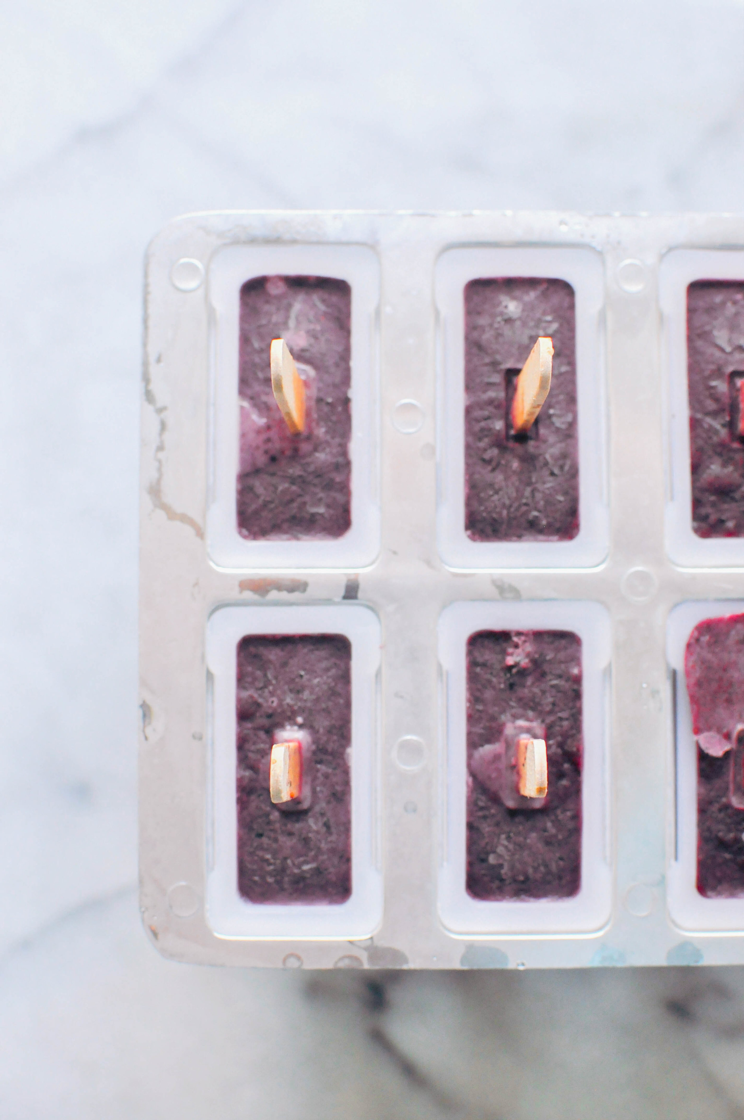 Blueberry Basil Coconut Milk Popsicles. A refreshing dessert | This Healthy Table