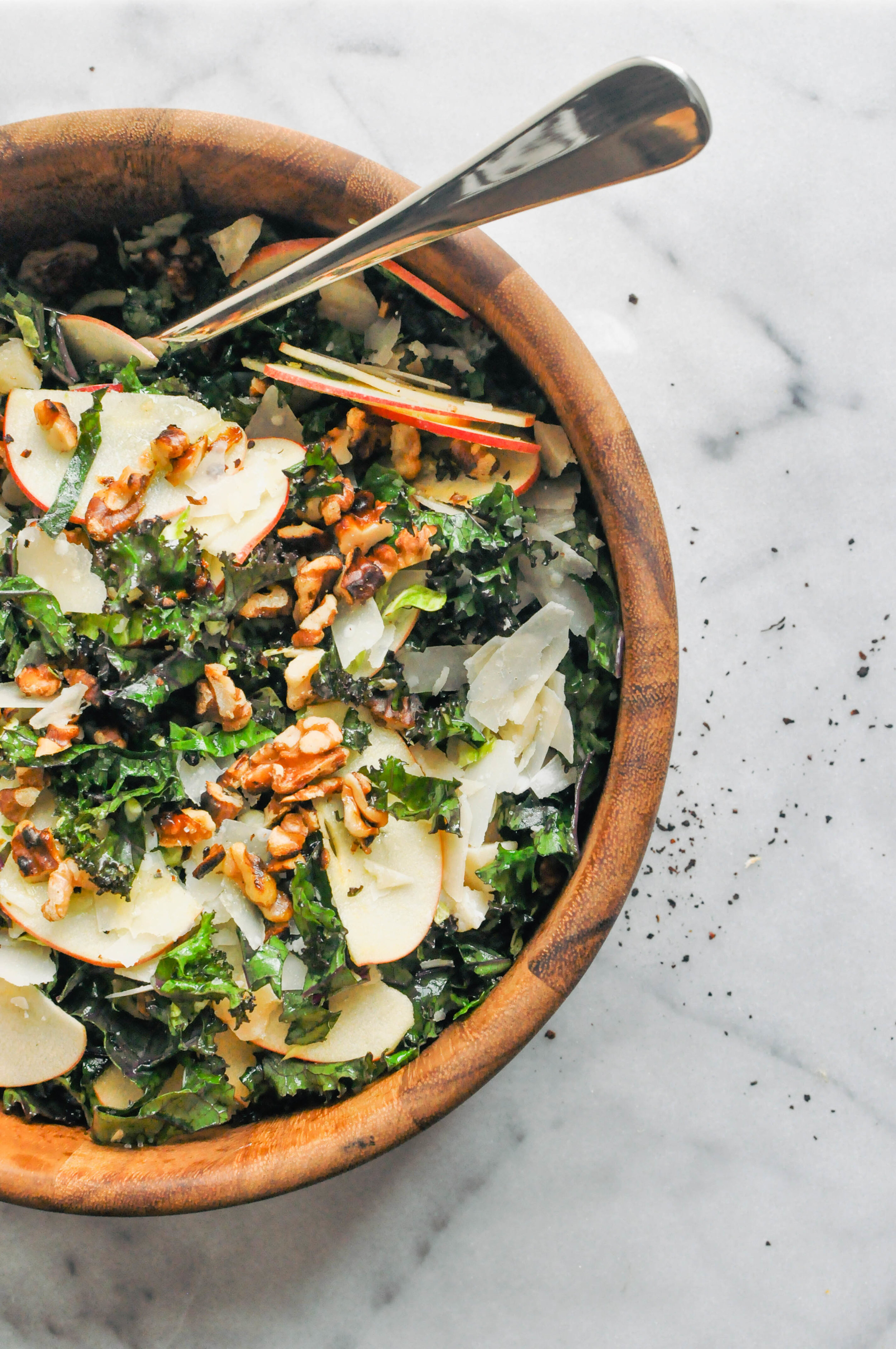 Shredded Brussels Sprouts, Kale, and Apple Salad Recipe. A delicious, vegetarian side salad | This Healthy Table