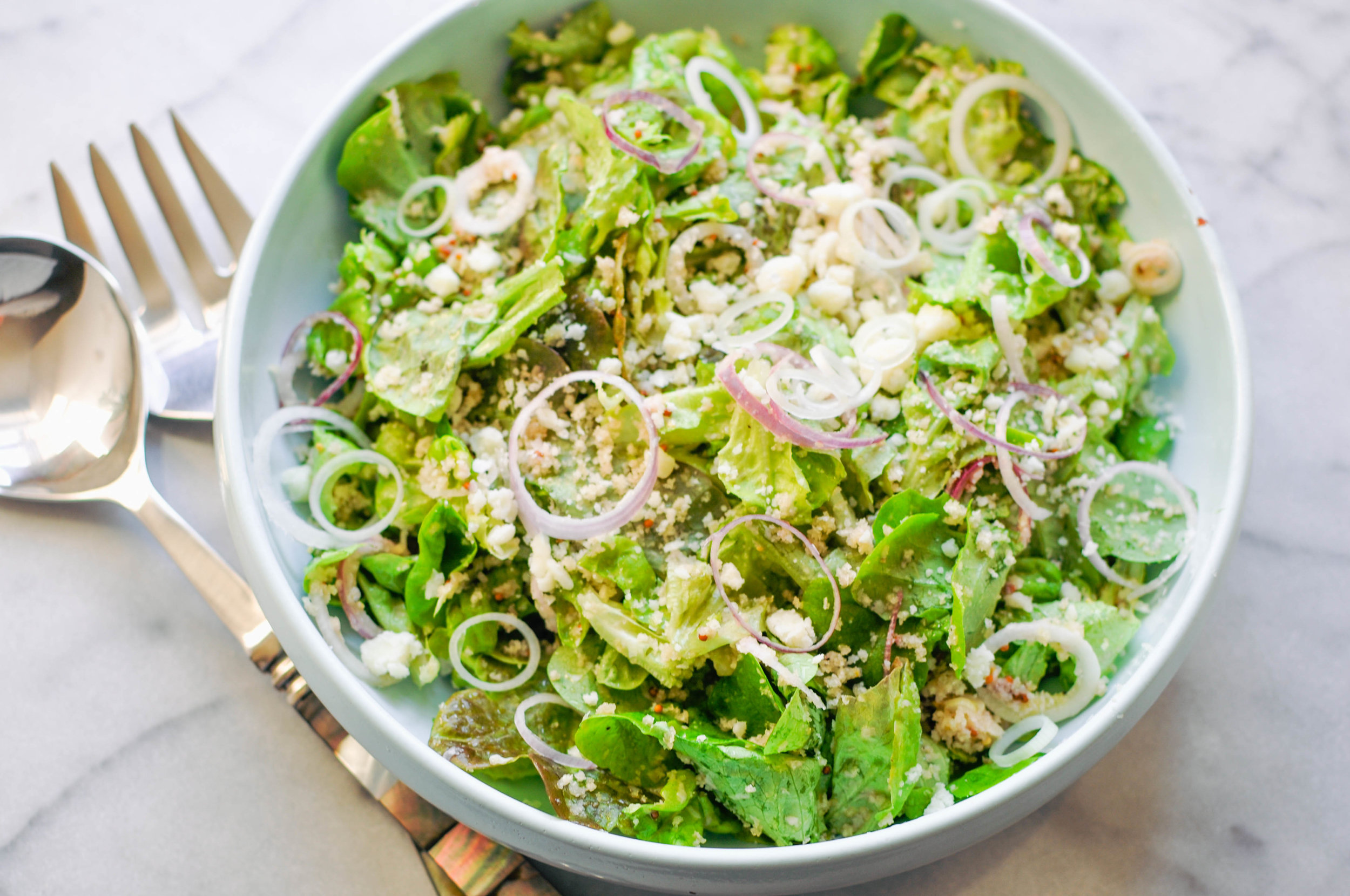 My Favorite Green Salad Recipe. A beautiful salad with butter lettuce, breadcrumbs, red spring onions, pecorino, and a red wine mustard dressing. | This Healthy Table
