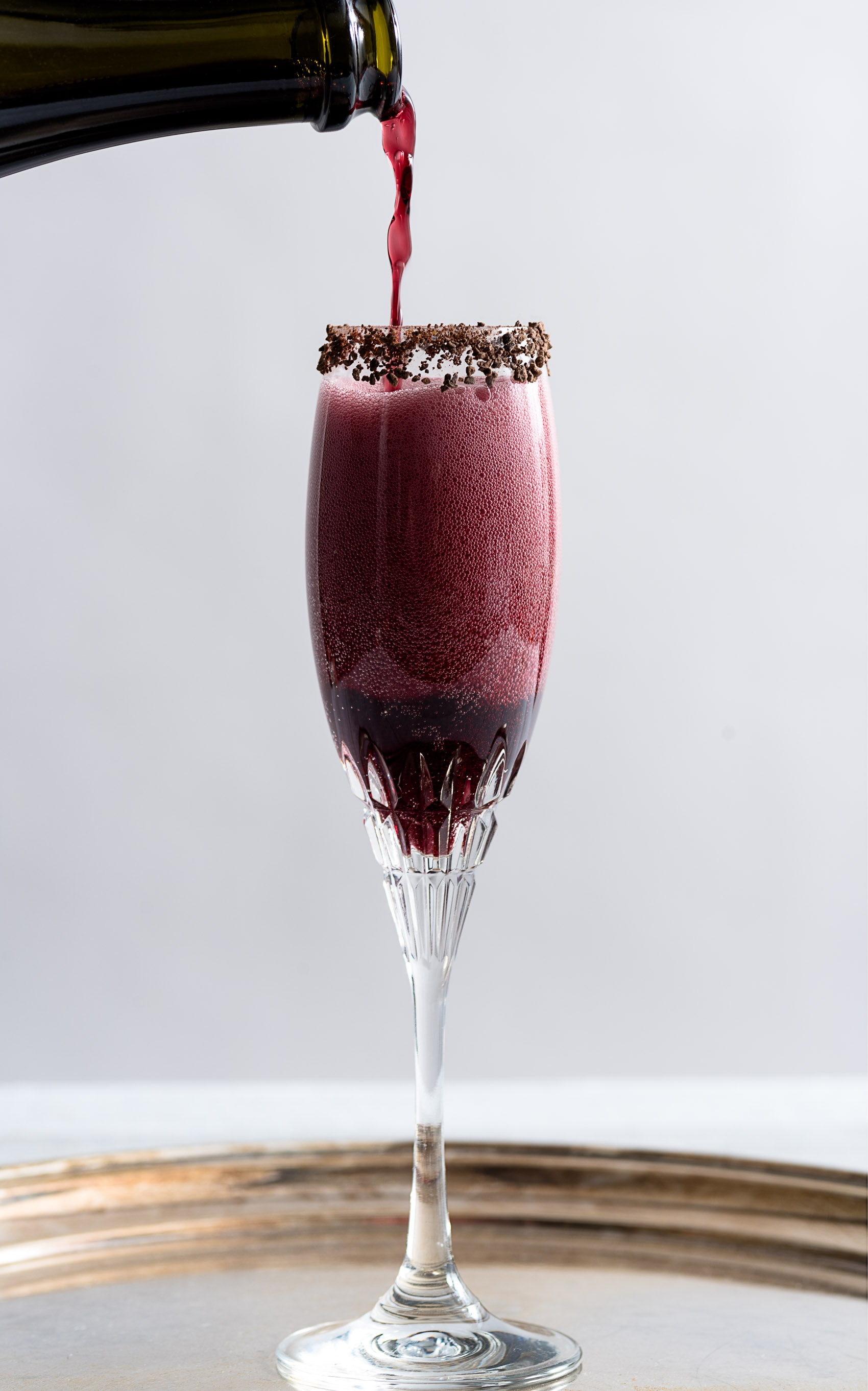 Sparkling Shiraz Cocktail with Dark Chocolate Coated Cacao Nibs from Nomageddon. Get the recipe here. -