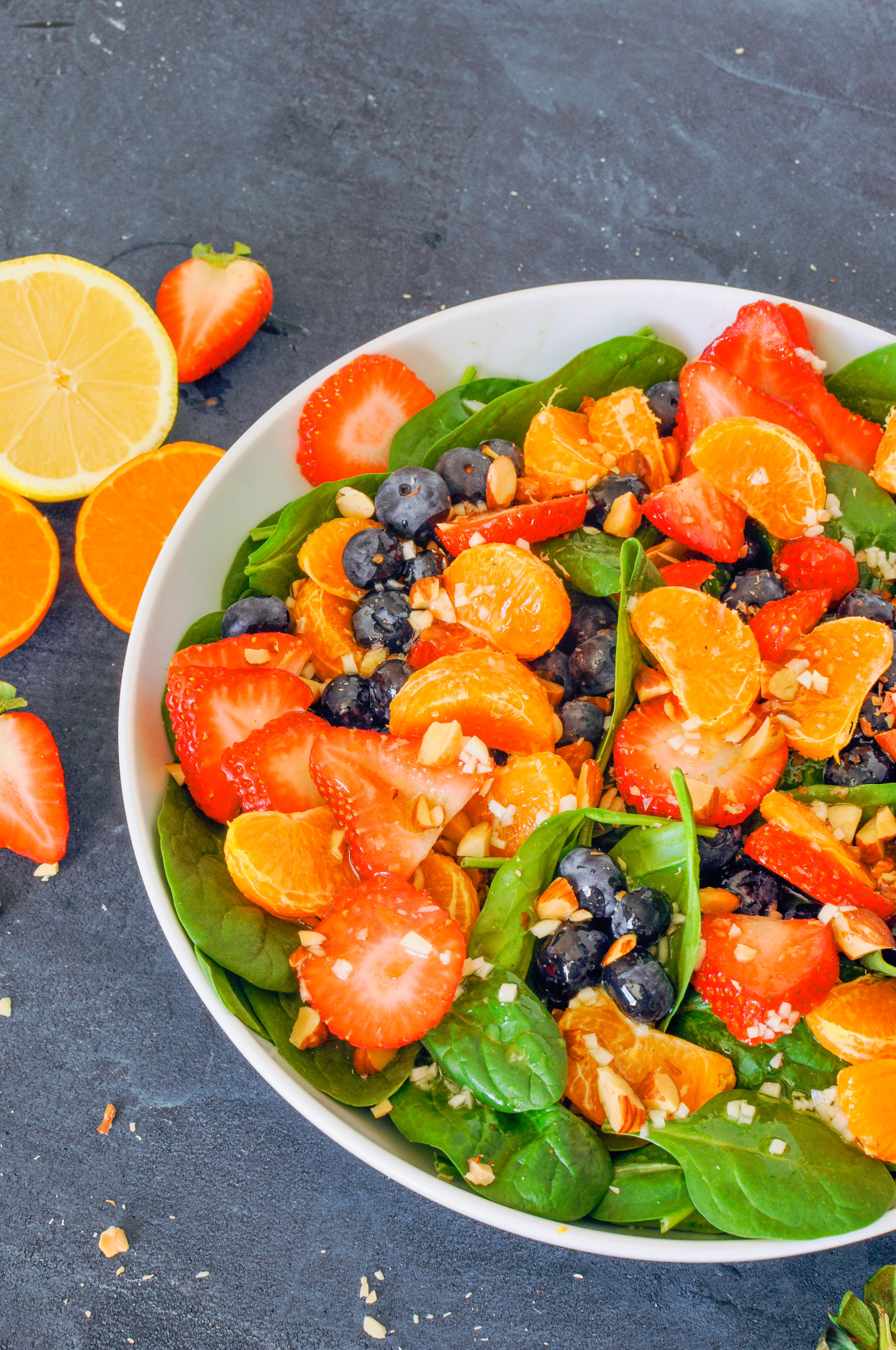 This energy boosting salad with citrus, berries, and spinach is easy, refreshing, and bright. (vegan and gluten-free)