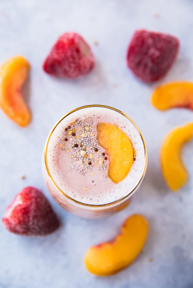 Tickled Pink Strawberry Peach Protein Smoothie from Kim's Cravings. Get the recipe here. -