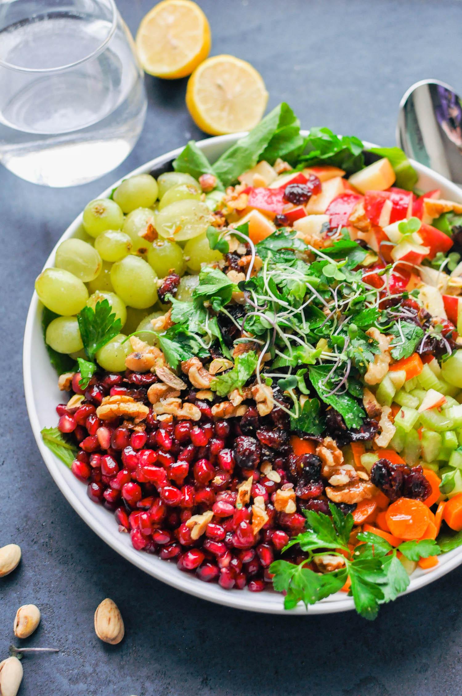 Detox Crunch Salad. A vegan salad full of grapes, apples, celery, pistachios, pomegranates, walnuts, and carrots. | This Healthy Table