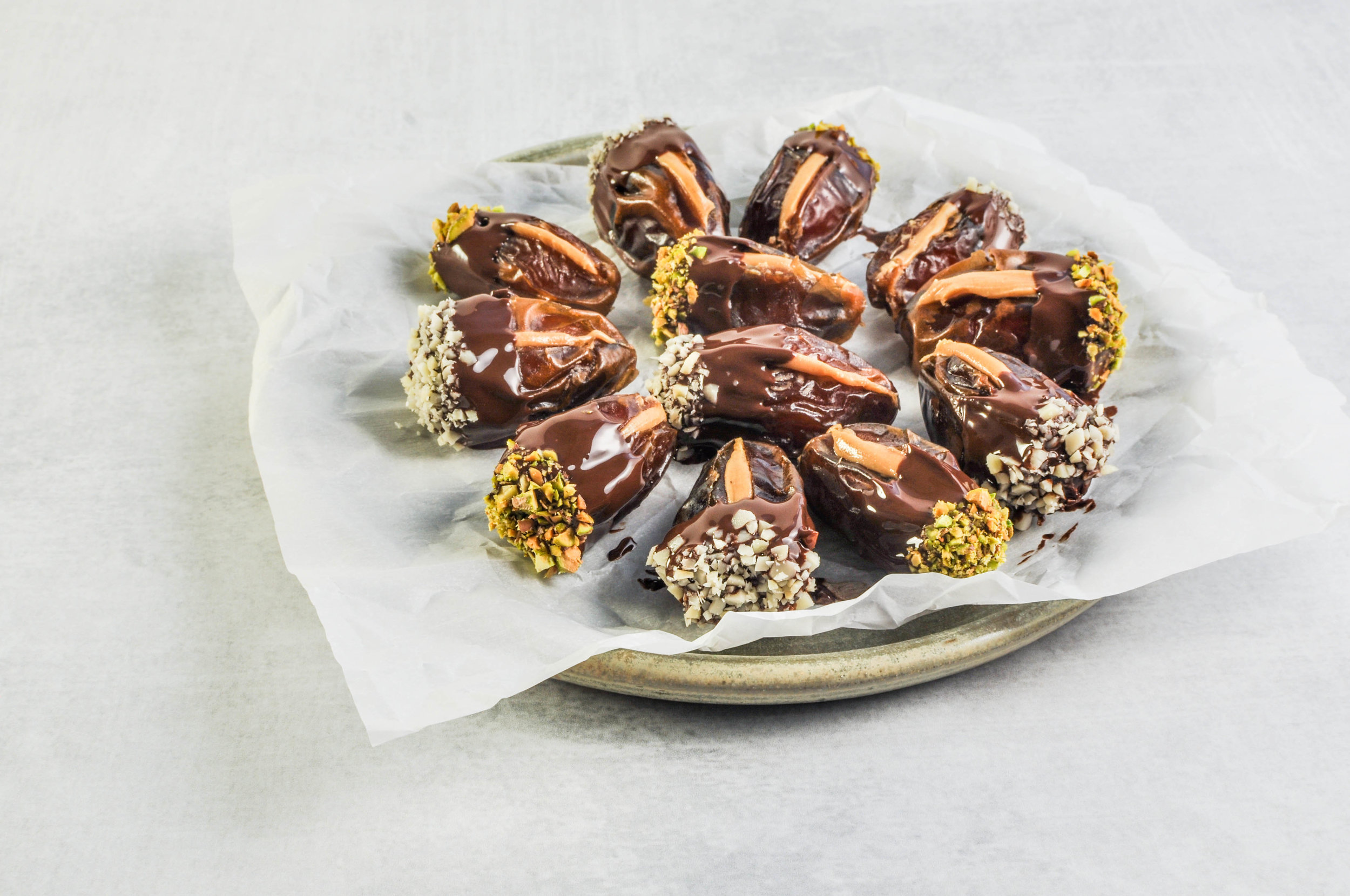 Peanut Butter Stuffed Chocolate Covered Dates with Almonds & Pistachios - a healthy, easy snack or dessert.