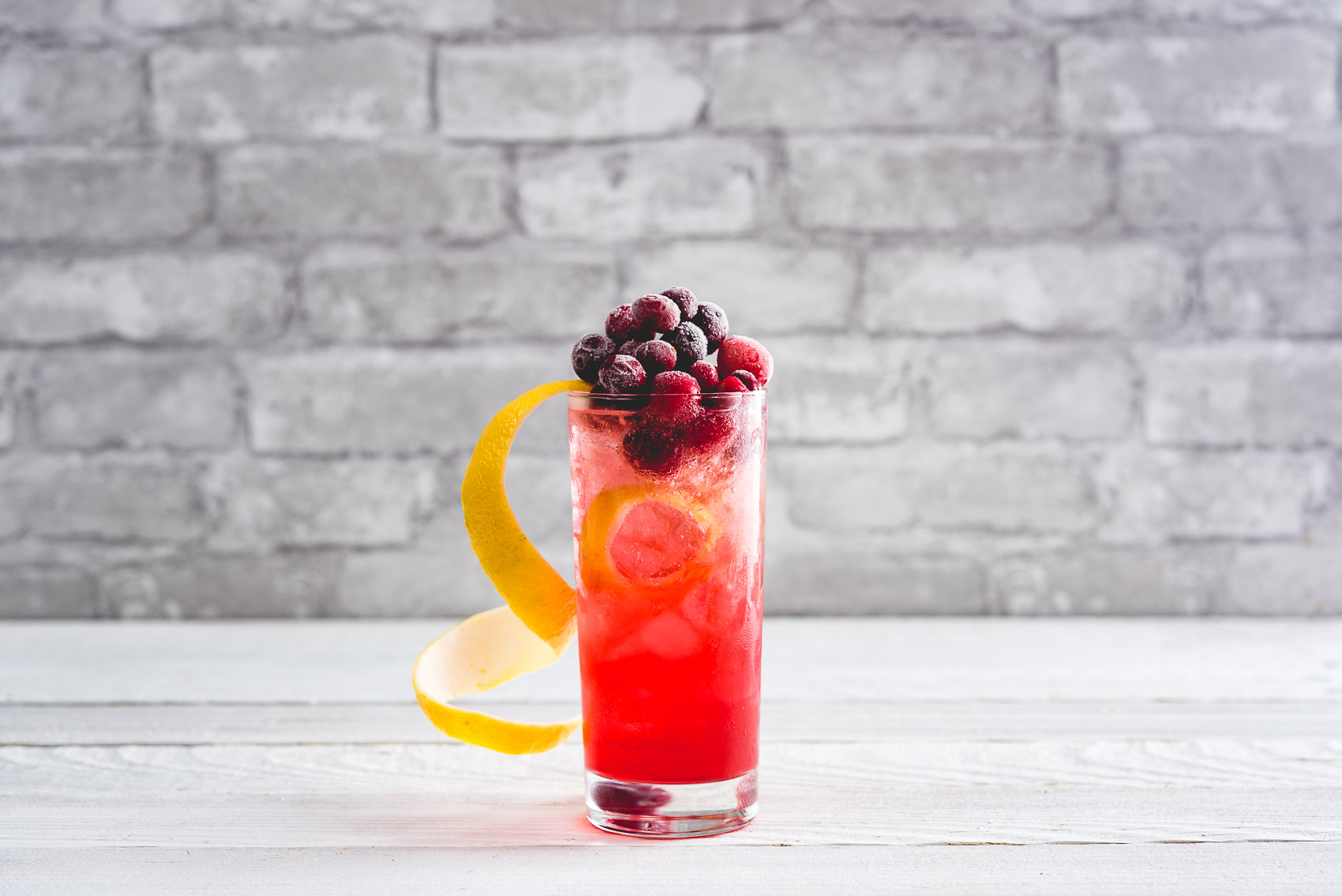 Tom Collins with Cranberry Cocktail from Nomageddon - The Cranberry Collins is a fall cocktail based on the Classic Tom Collins. The perfect Thanksgiving Cocktail.