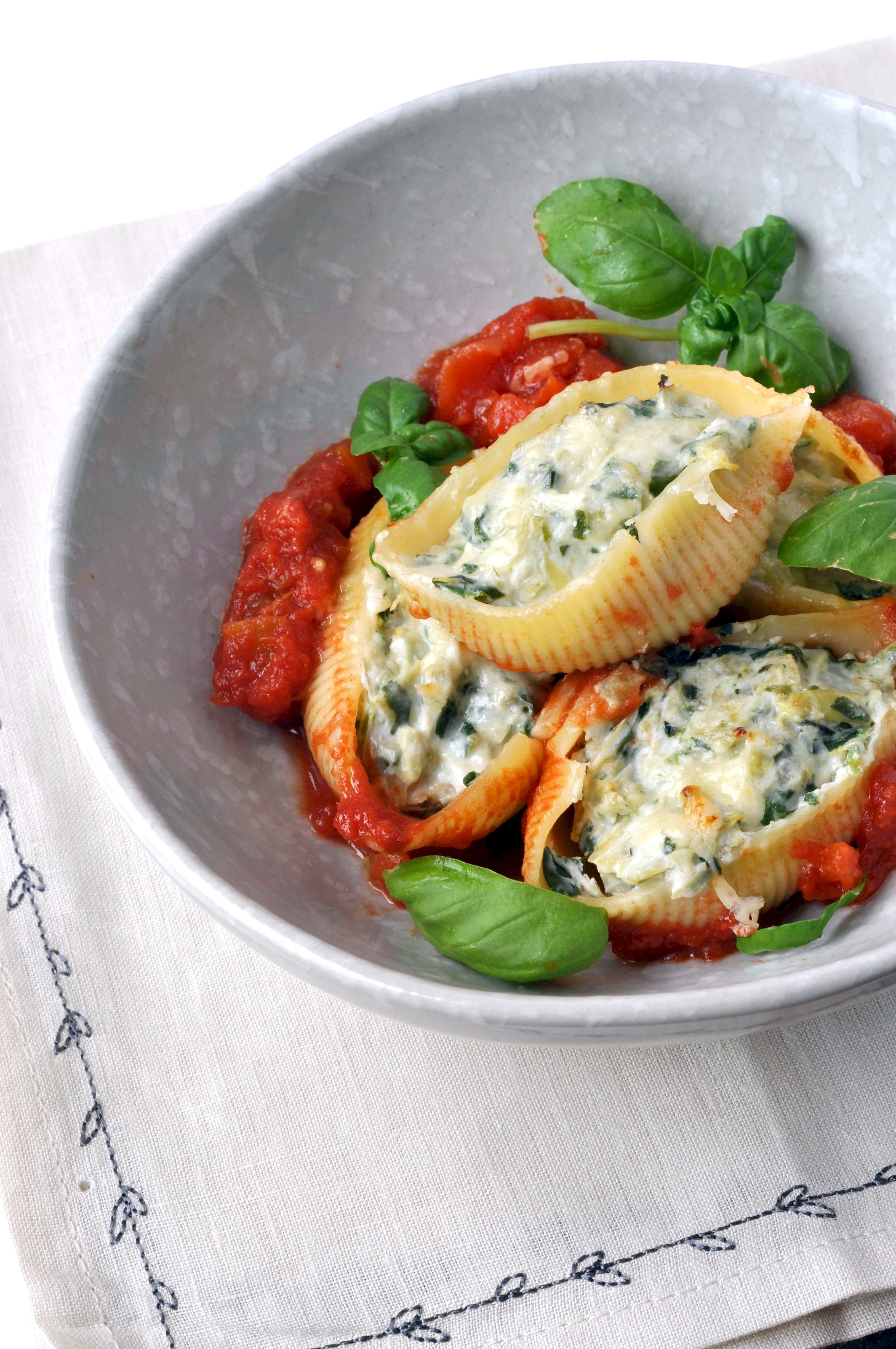 Spinach Artichoke Stuffed Pasta Shells from This Healthy Table - I did not invent the spinach artichoke combo, but that should not dissuade you from making this delicious recipe.