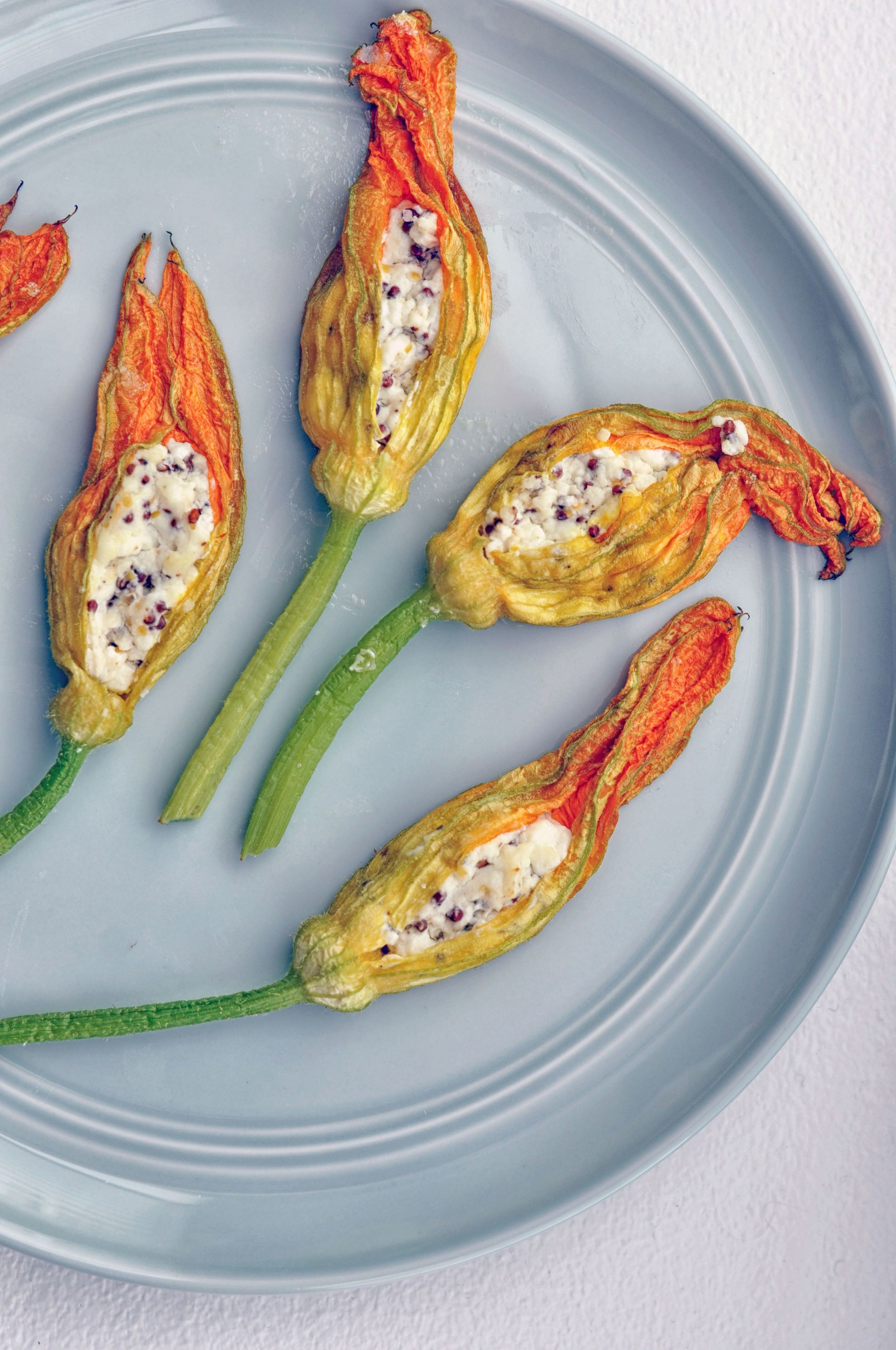 Baked Stuffed Squash Blossoms - These baked stuffed squash blossoms are a delightful treat! They are creamy, tangy, and wonderfully floral.