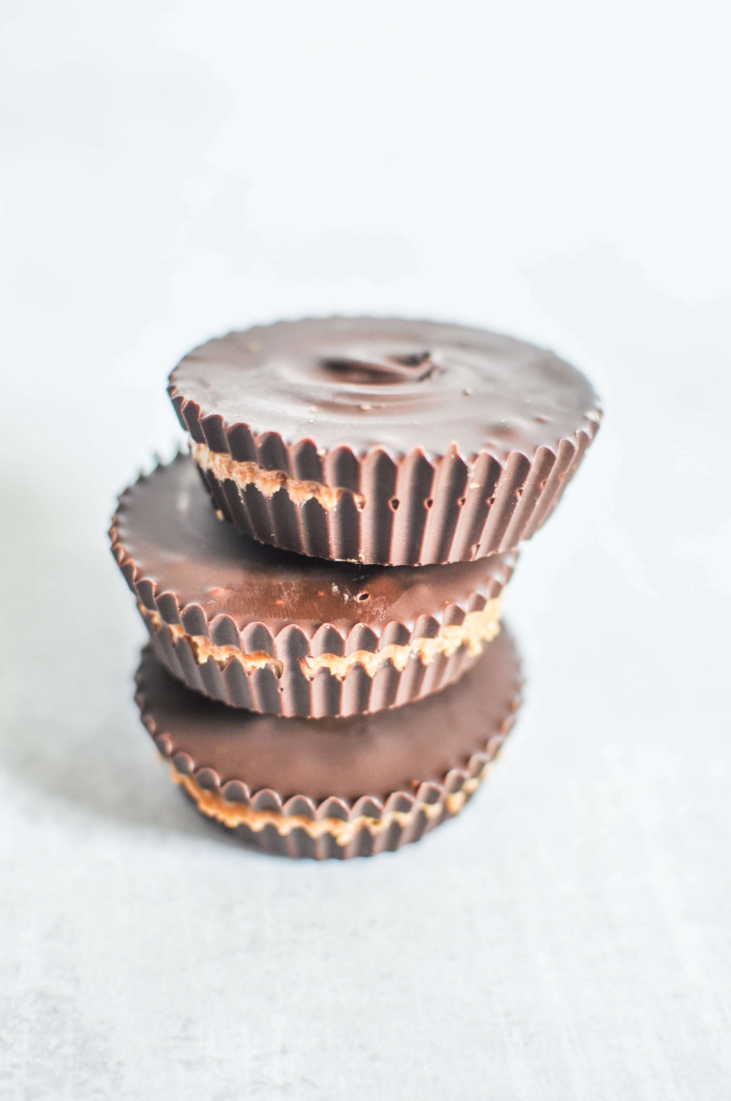 Healthier 2-Ingredient Peanut Butter Cups - You are going to love this easy peanut butter cup recipe! They're ready in less than 15 minutes (I know, how is this even possible?) and they taste great.