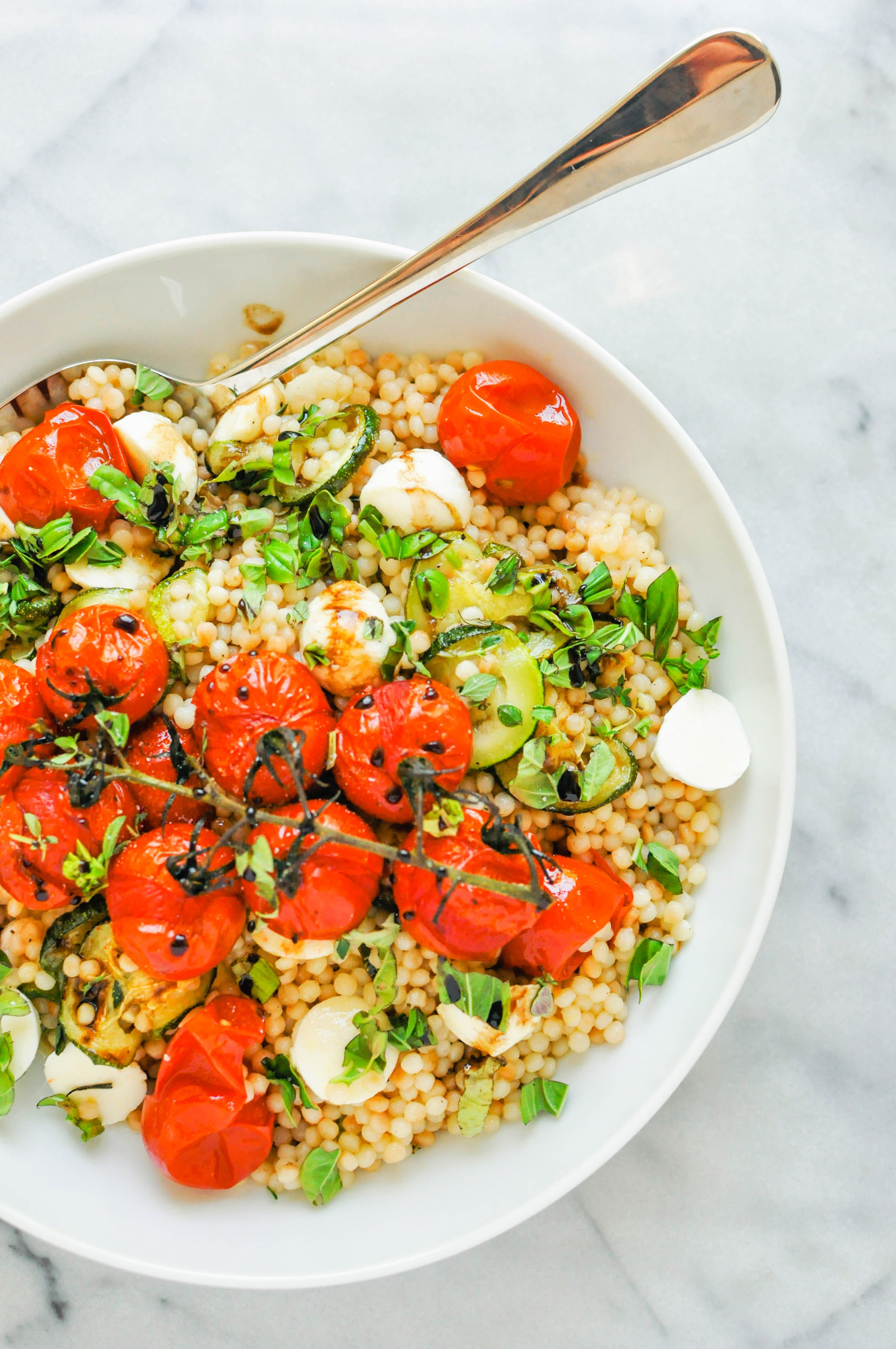Israeli Couscous Salad with Zucchini, Mozzarella, & Tomatoes - This Israeli couscous salad with zucchini, mozzarella, and tomatoes is hearty and full of bright flavors. It's a delicious side dish or lunch option.