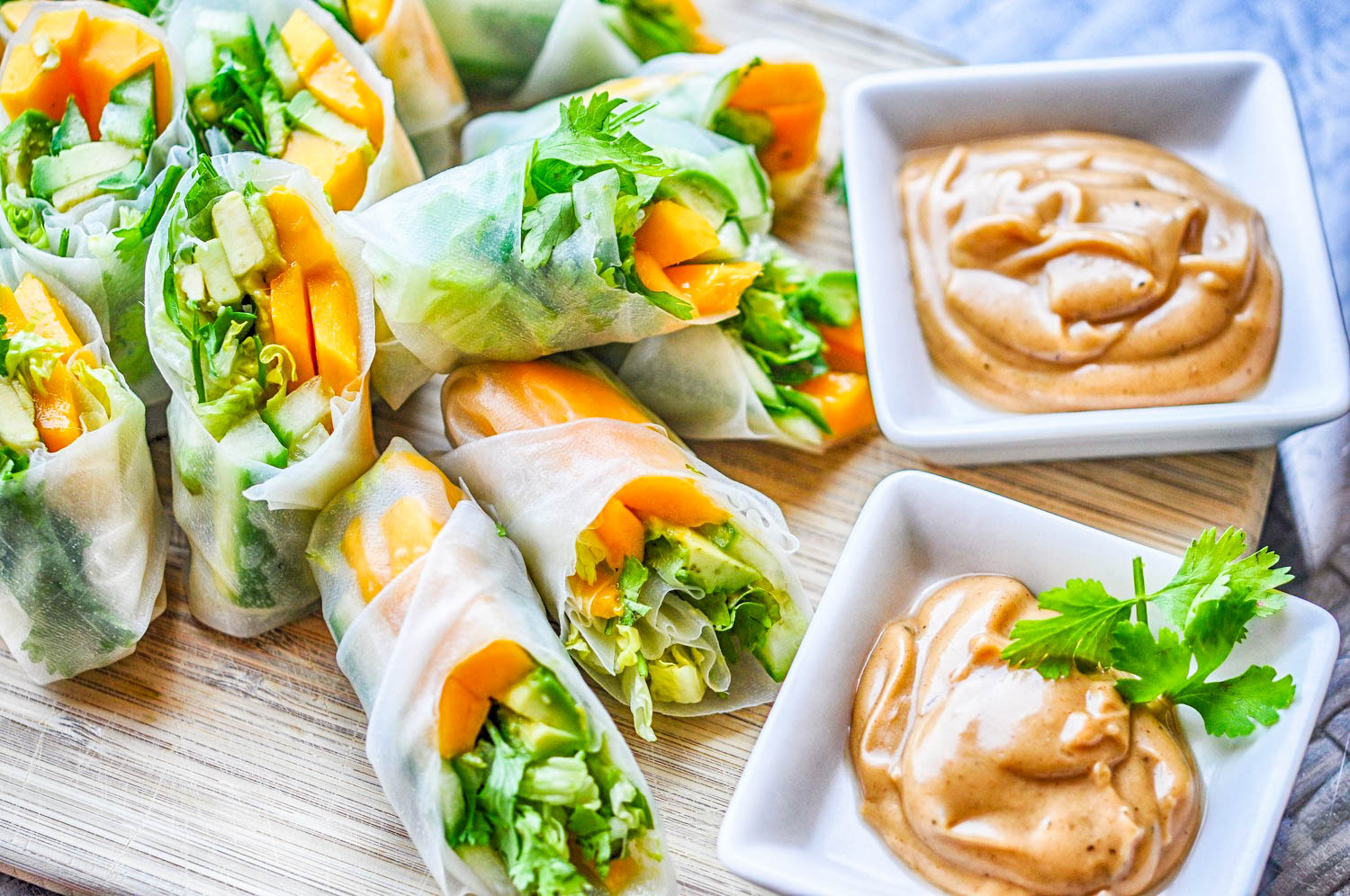 These tropical vegan summer rolls with a peanut dipping sauce are a healthy, colorful, and delicious recipe!