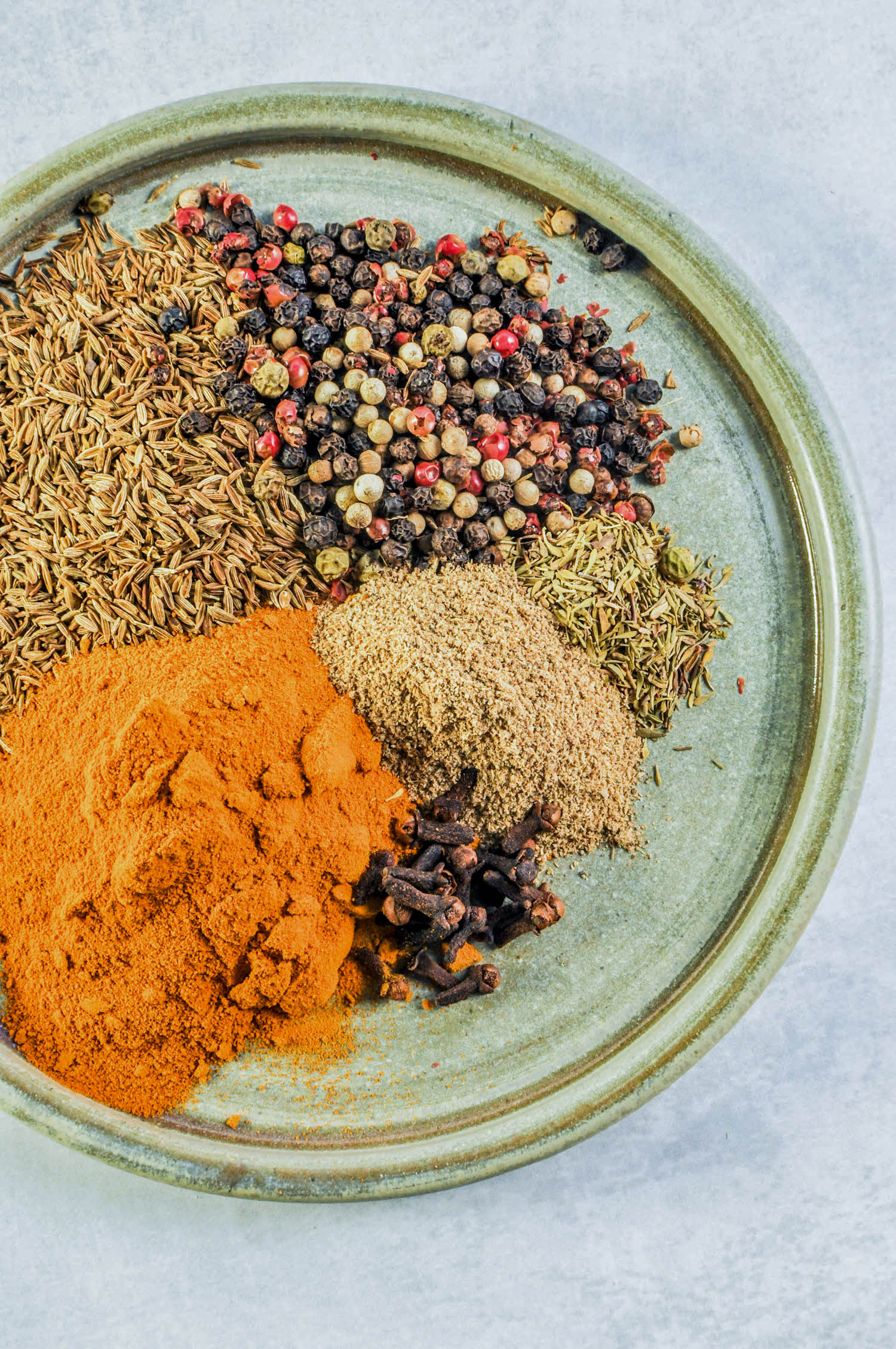 "Hawaij Spice Guide from This Healthy Table. Hawaij (also known as Hawayej, Hawaj, and Hawayij) means ""mixture"" in Arabic. It's a spice blend with primarily cumin and black pepper and often contains cardamom, coriander, turmeric, cinnamon, ginger, and cloves."