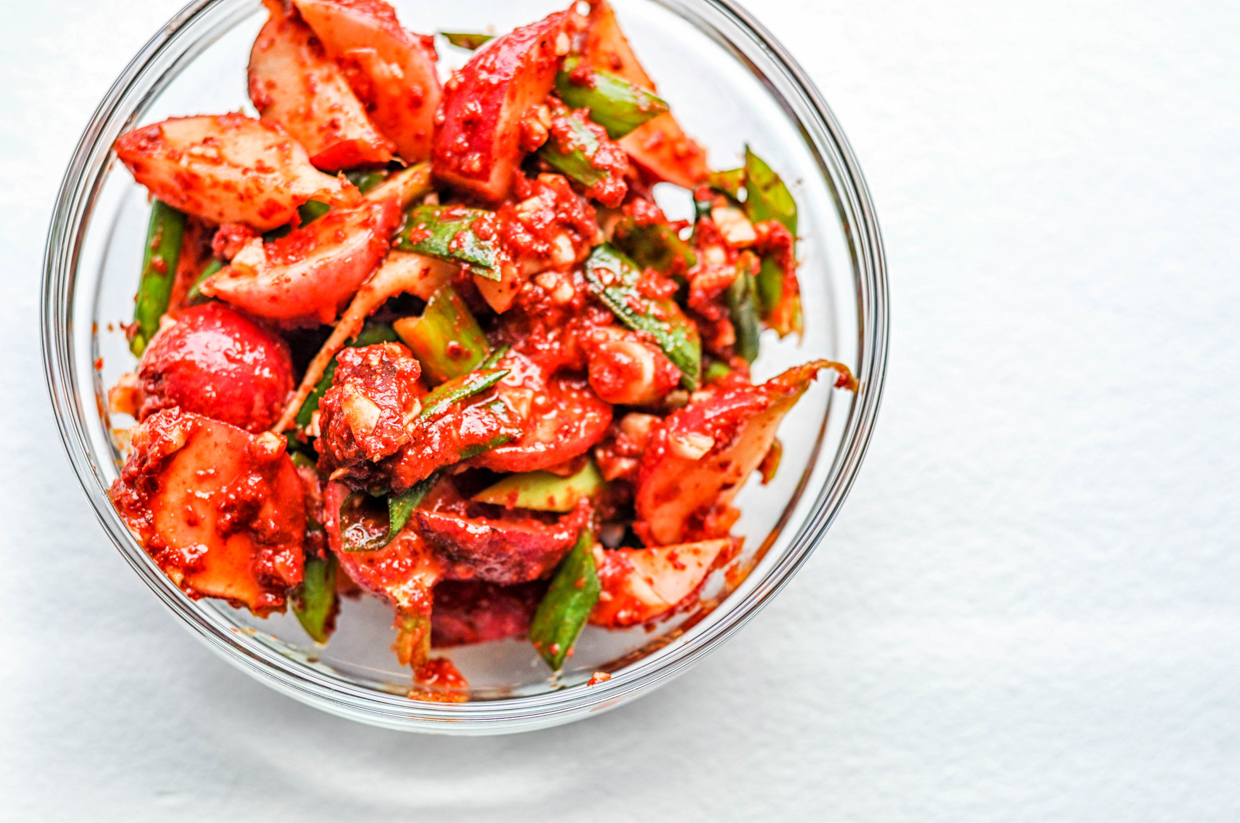 This quick and easy kimchi recipe is going to be one of your favorites! It only takes a few minutes to make it (plus a few days for it to ferment).