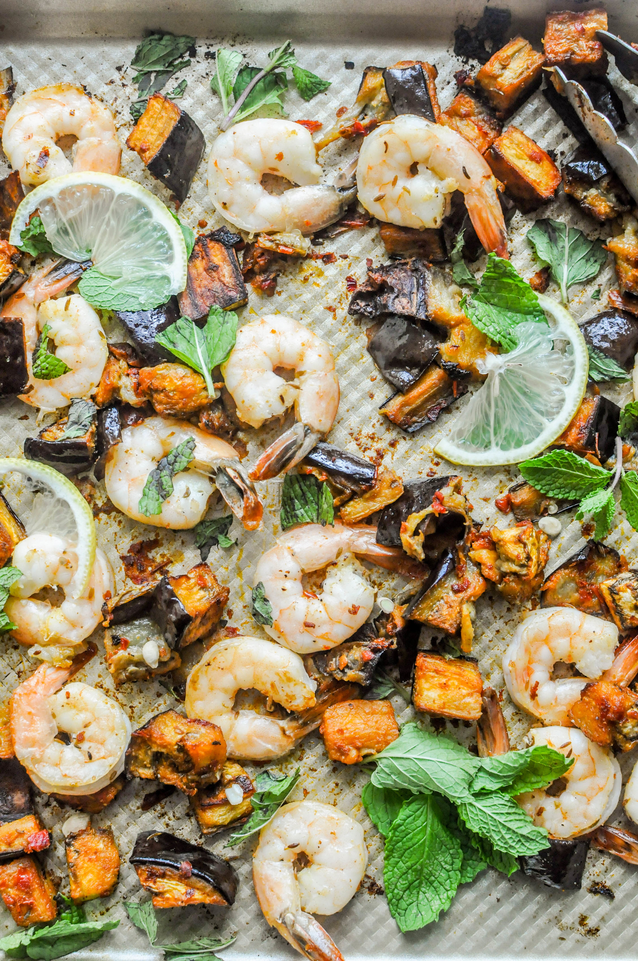 This roasted eggplant and shrimp with harissa tray bake recipe is flavorful and ready in only 40 minutes (much of which is hands-off time). The eggplant becomes so soft and succulent - it almost melts in your mouth.