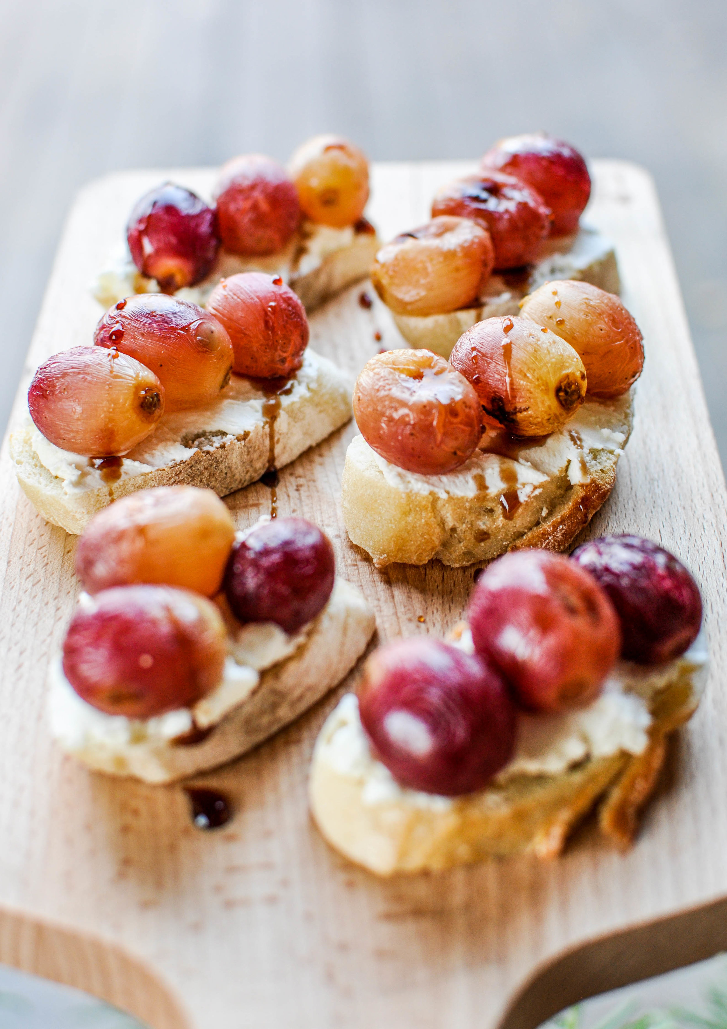 These roasted grape crostinis are an easy and tasty appetizer recipe that is perfect for a dinner party!