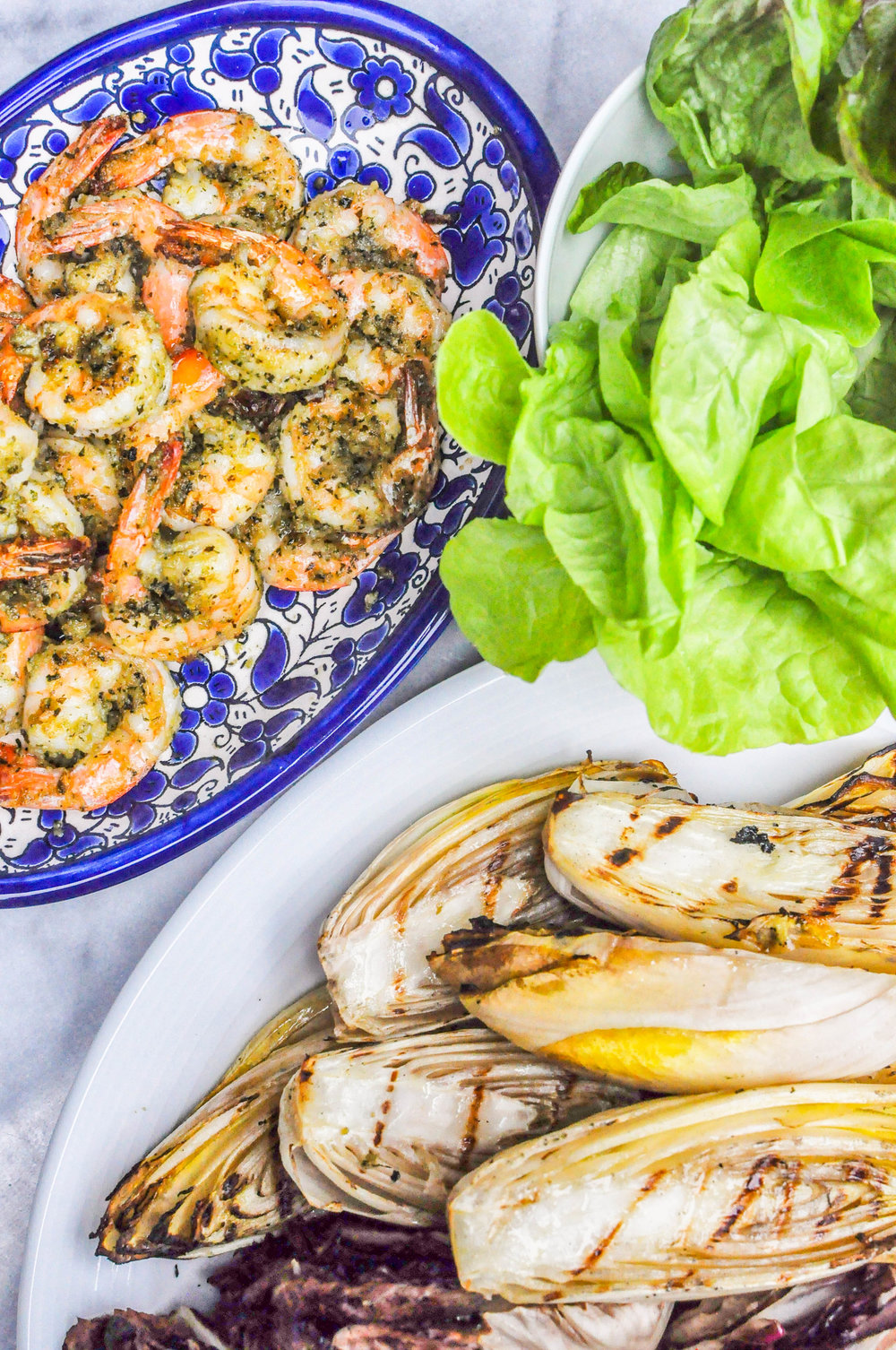 Grilled Shrimp and Endives Recipe from This Healthy Table. Get the recipe here.  - This pesto shrimp recipe is ready in under 30 minutes!