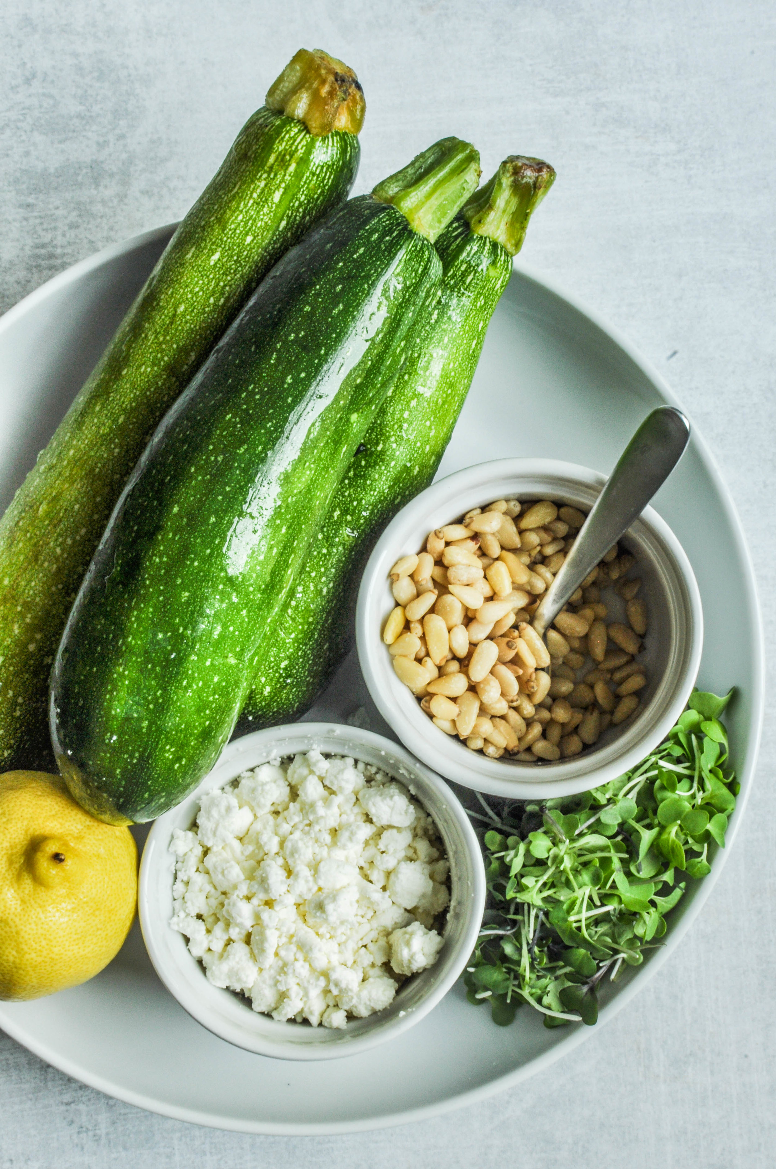 This shaved zucchini recipe is fabulous side dish with goat cheese, pine nuts, lemon, and microgreens.