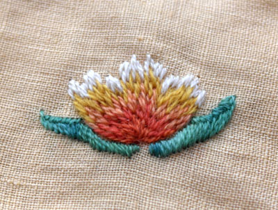A piece of crewel wool embroidery in process.