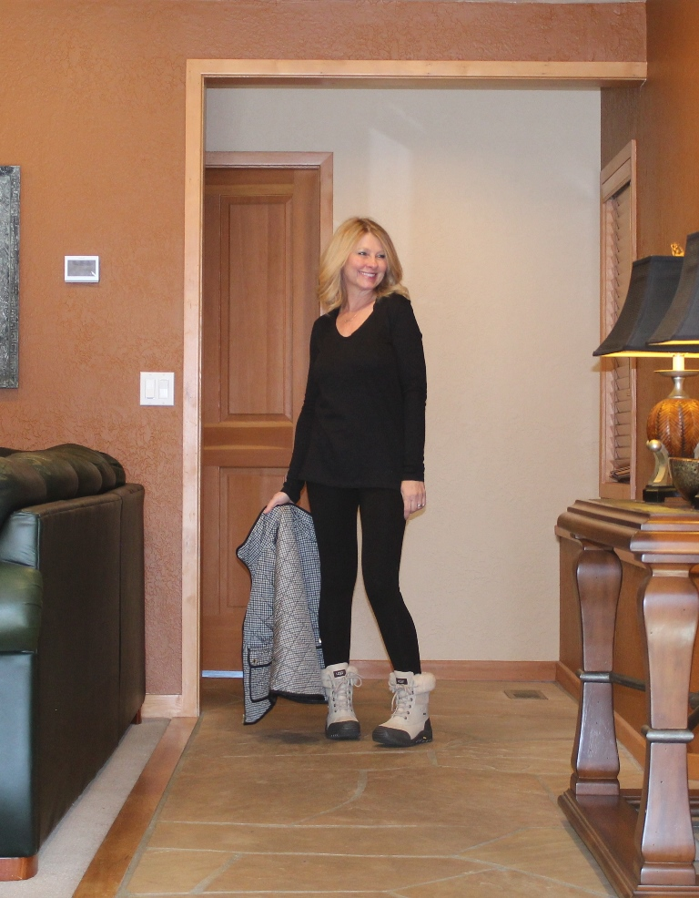 Column - just a pair of black leggings with a black tee.