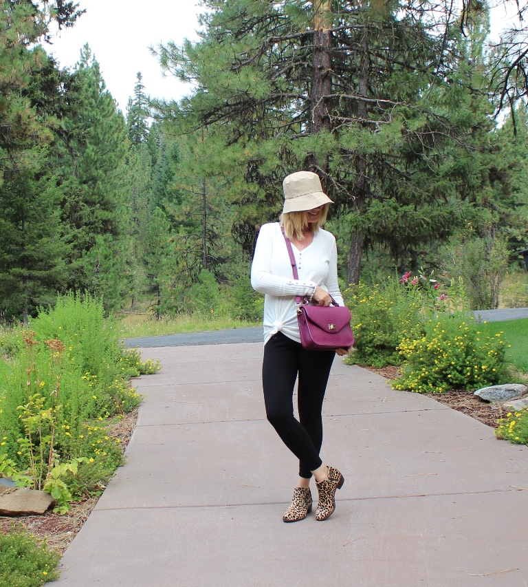 Look 6 - In this last look I am wearing a thermal top knotted to the side, a pair of leopard booties and a bucket hat. For a bag I am carrying my Gigi crossbody bag.Bucket hats are so big for fall! I have had this one forever and have used it a lot when it rains. I am loving this little trend to add a little pop of fun to a look.