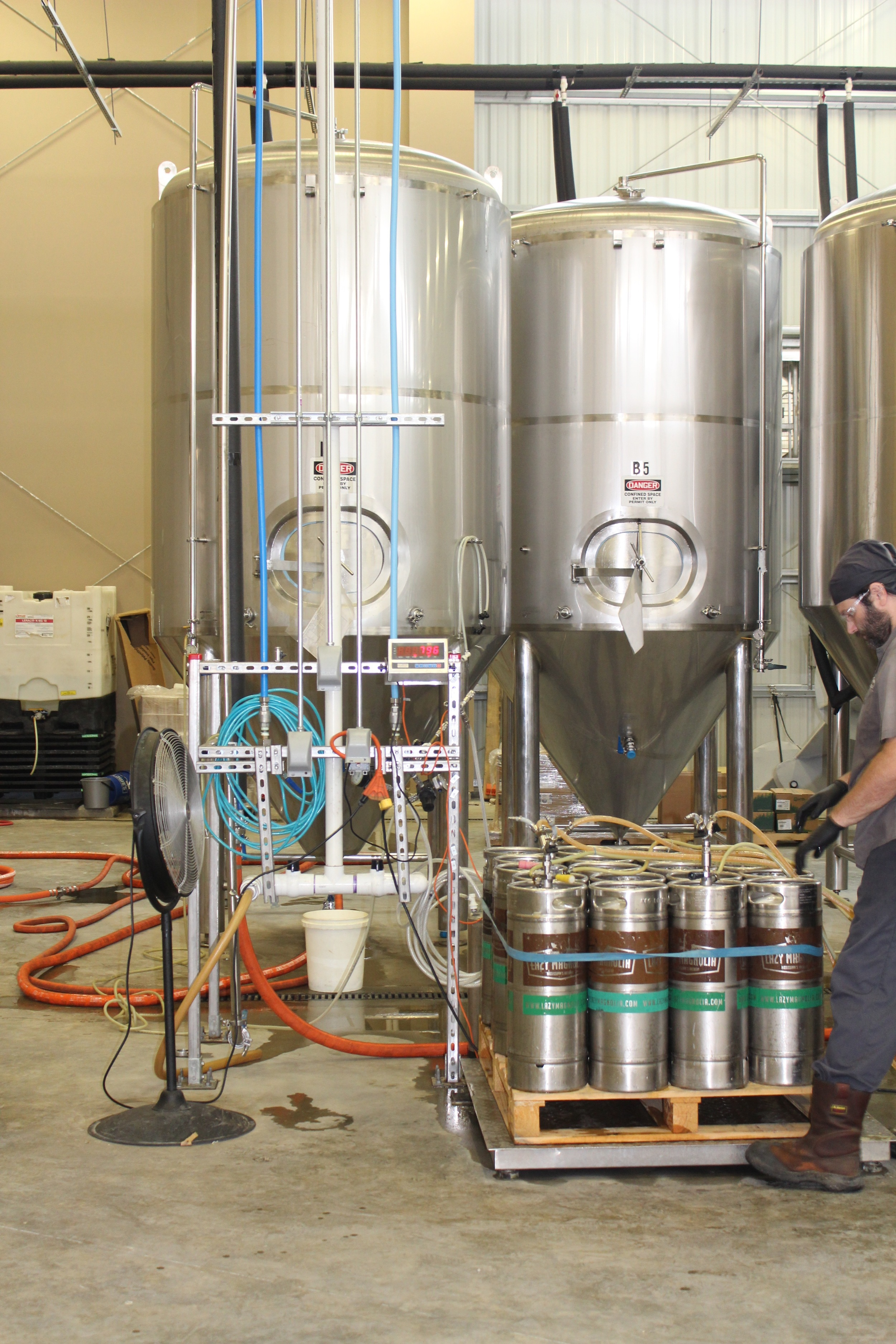 Filling up pony kegs at Lazy Magnolia Brewing Company in Kiln, Mississippi