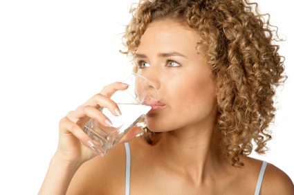 Lady drinking a glass of water.jpg