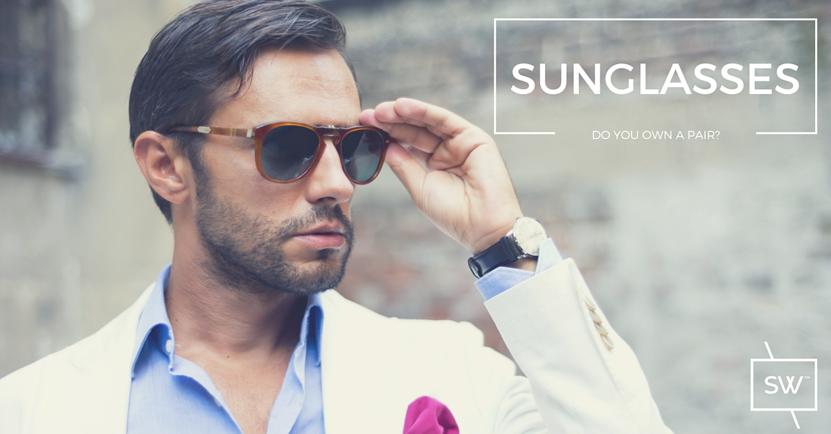 Photo: Stylish man in sport coat wearing tortoise shell with grey lens sunglasses