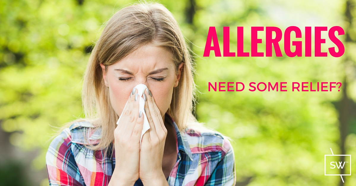 Photo: Lady blowing her nose because of seasonal allergies