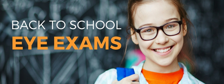 Photo: Young child with eyeglasses smiling wearing orange shirt with blue backpack getting ready to head back to school