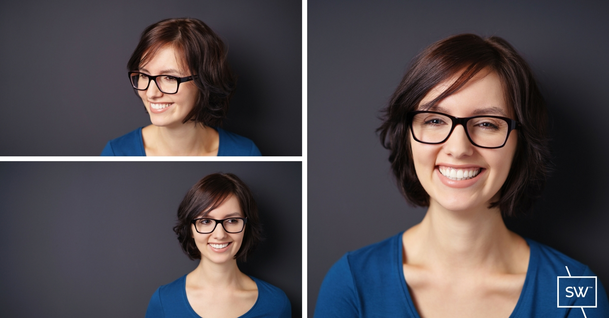 Photo: Young lady smiling and wearing eyeglasses with anti-reflective lenses