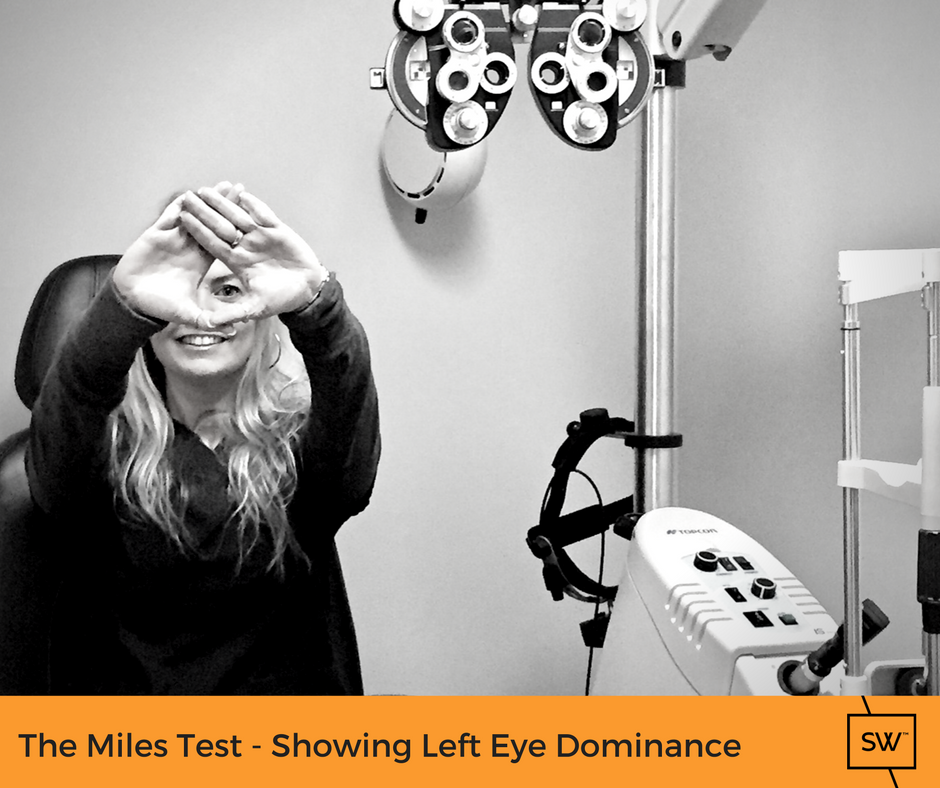 Stonewire staff member demonstrating the miles test - showing left eye dominance