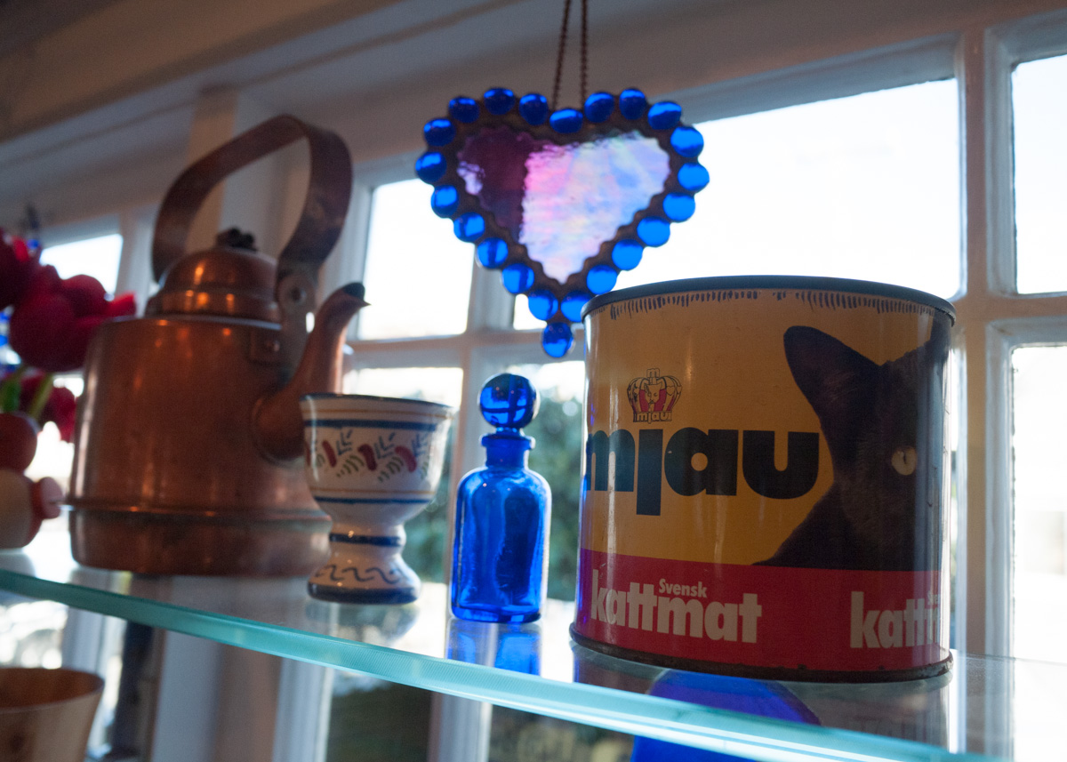 Stained glass heart by Abbe Owens Baze, paired with Swedish cat-food can.