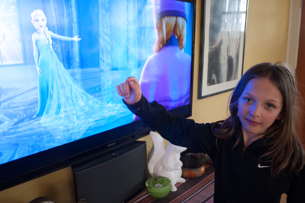 """While watching """"Frozen"""" together, Ruby points out the particulars of Elsa's gown."""
