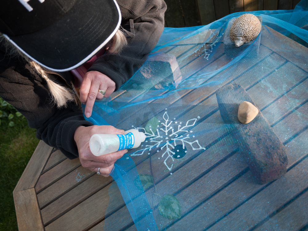 Apply snowflakes with Stickles, freehand or with a pattern.