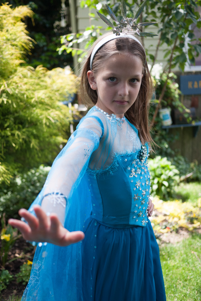 Gesturing like Elsa, Ruby's costume is three simple parts; blouse, bodice, skirt and train.