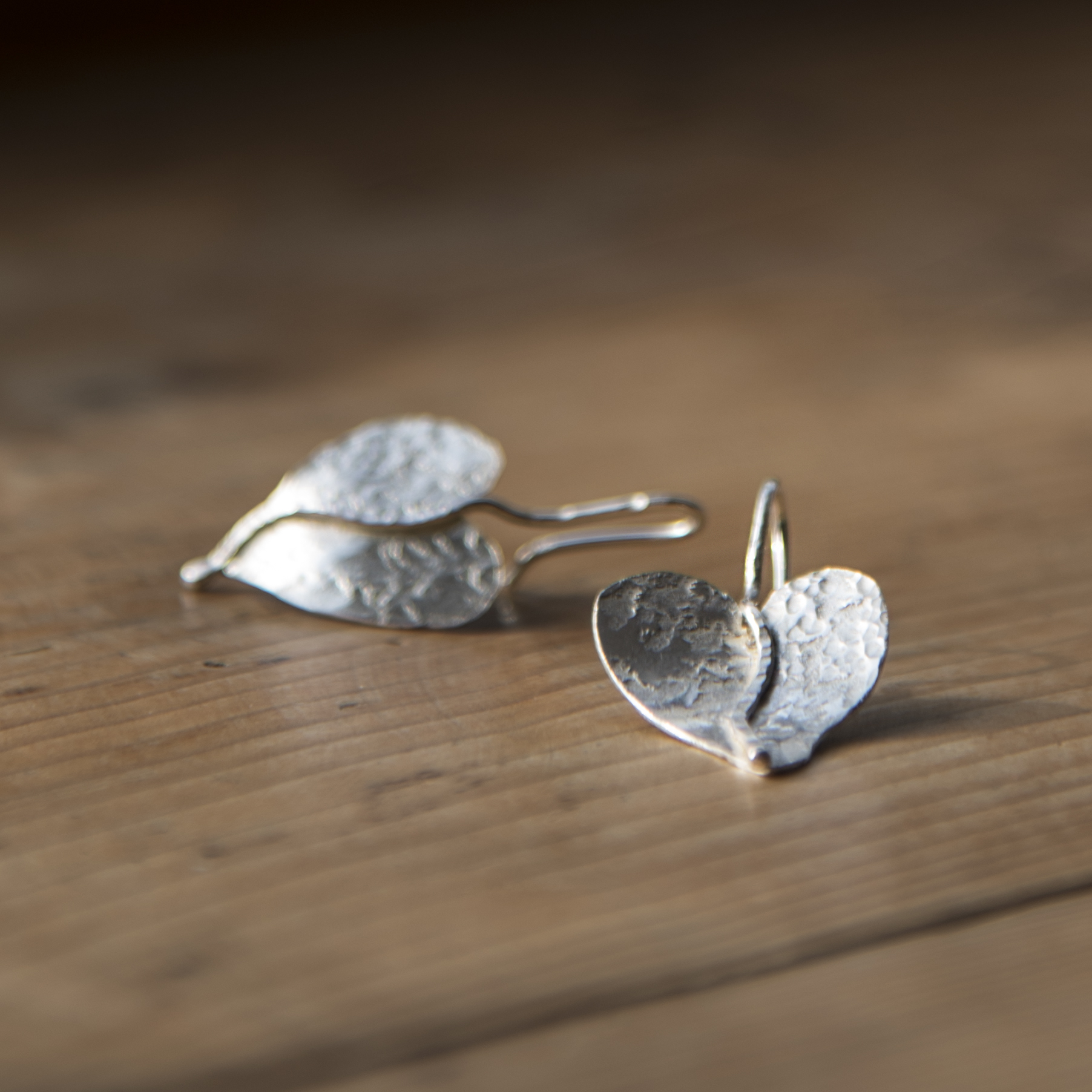 Beaten silver asymetrical heart shaped earrings by Oriana Jewellery.jpg