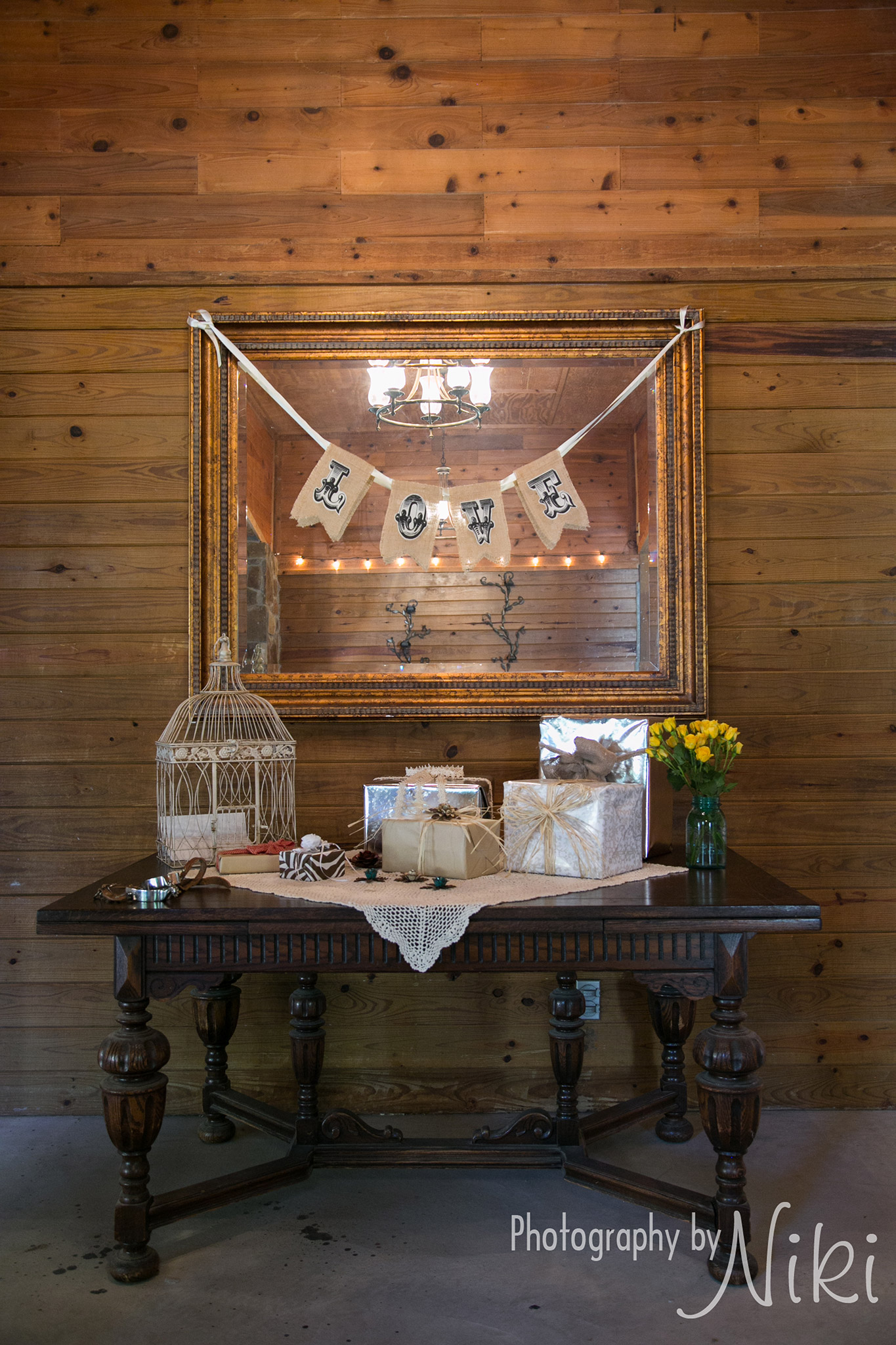 Decorated gift table with rustic charm located in the foyer.