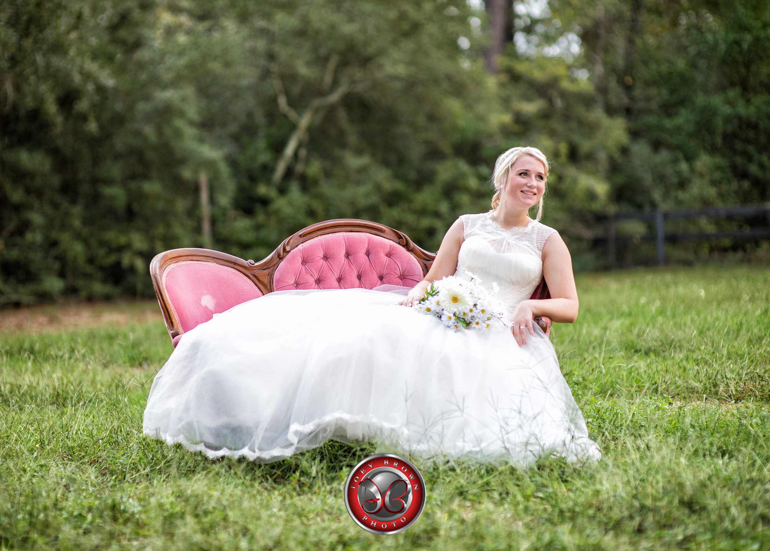 A bride poses on a rustic couch during her Bridal Shoot.