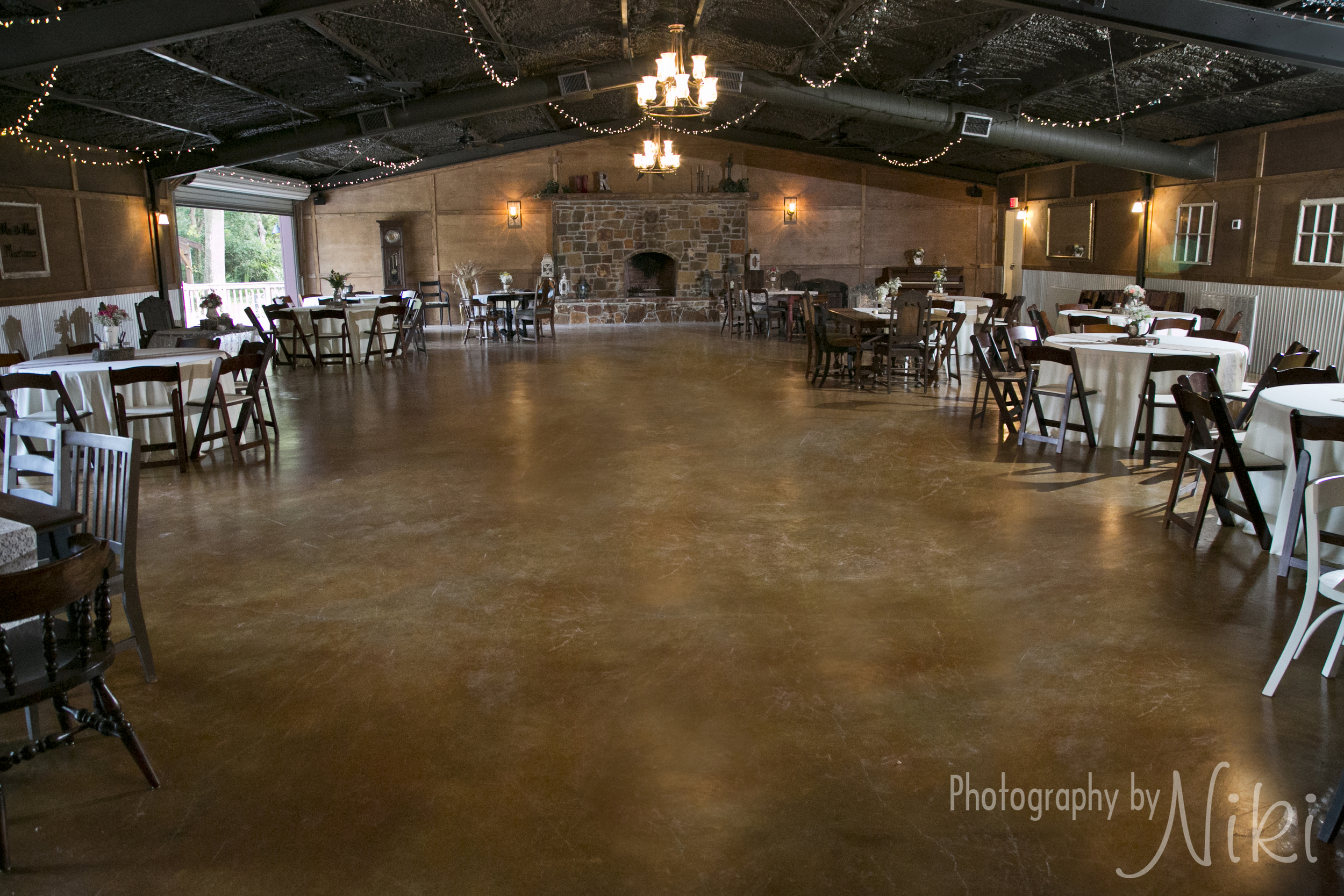 The Reception Hall decorated with rustic tables and chairs.