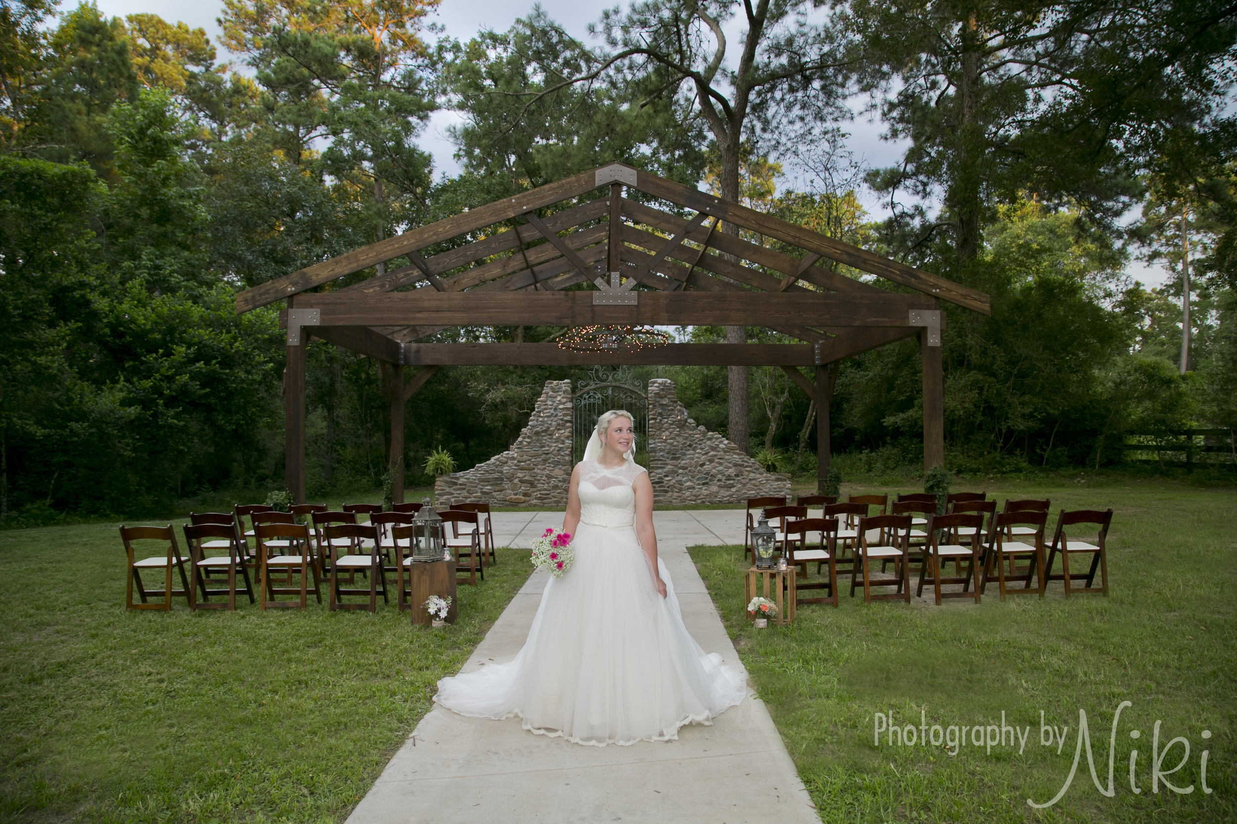 Ceremony Site with our openair Chapel, rock wall with antique gates and a beautiful bride.