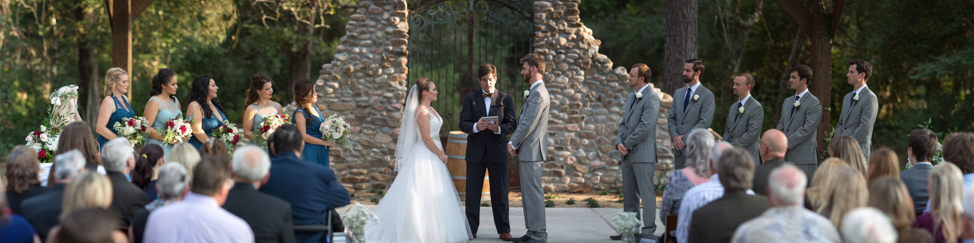 """A bride and groom preparing to say their """"I-do's"""" under our gorgeous outdoor Ceremony Site."""