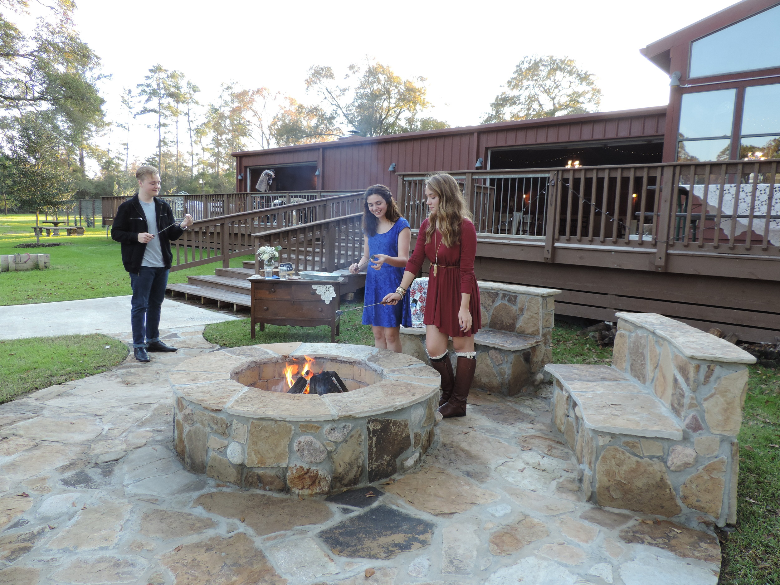 Some youngsters enjoying the large outdoor fire pit.