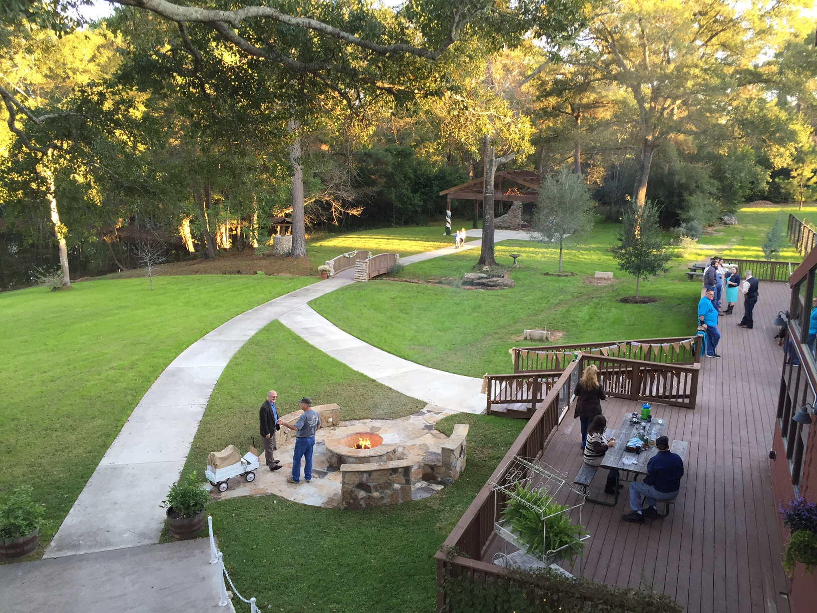 An over view of the outdoor Reception Area with large fire pit.