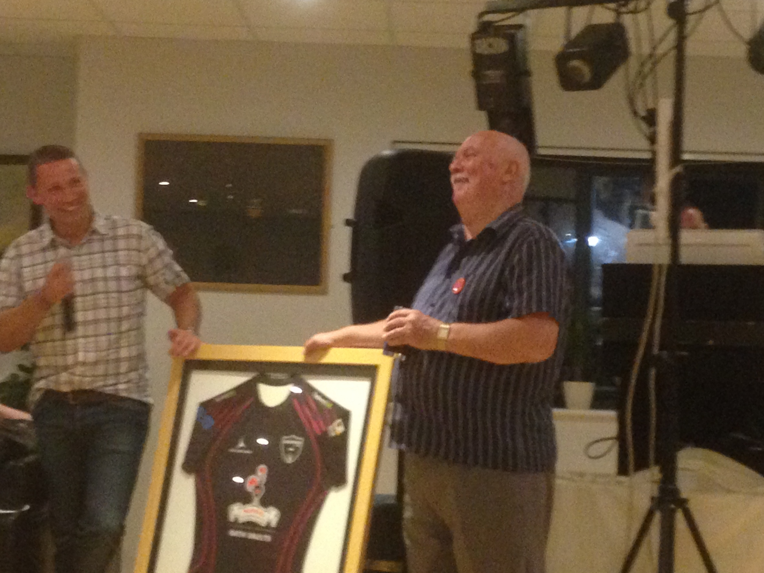 Don Senior receives a framed Godfathers shirt from Don Junior at his 70th birthday bash at Trowbridge RFC